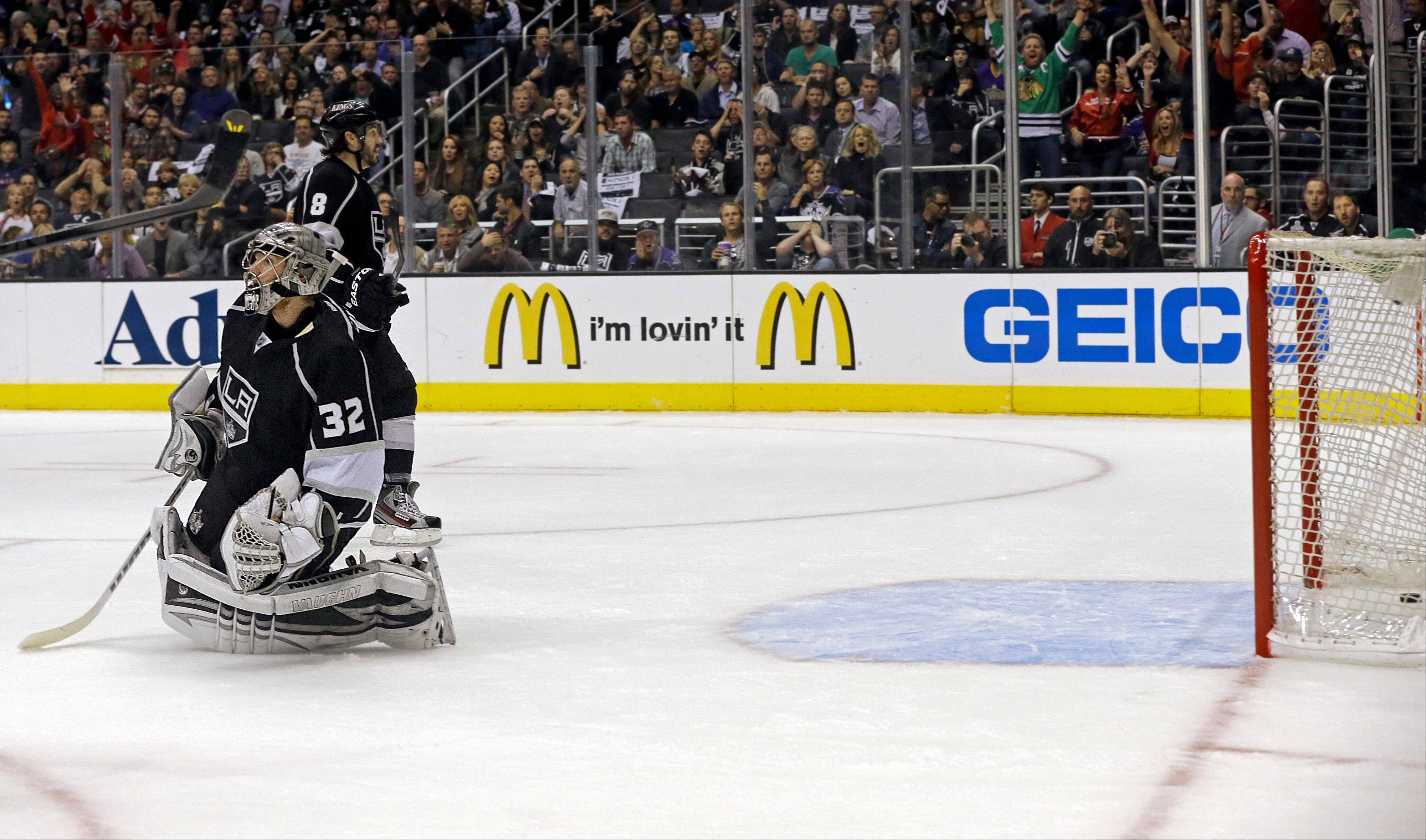 Los Angeles Kings goalie Jonathan Quick (32) kneels outside the goal after a goal by Chicago Blackhawks left winger Bryan Bickell during the first period of Game 3 of the NHL hockey Stanley Cup playoffs Western Conference finals, in Los Angeles on Thursday, June 6, 2013.