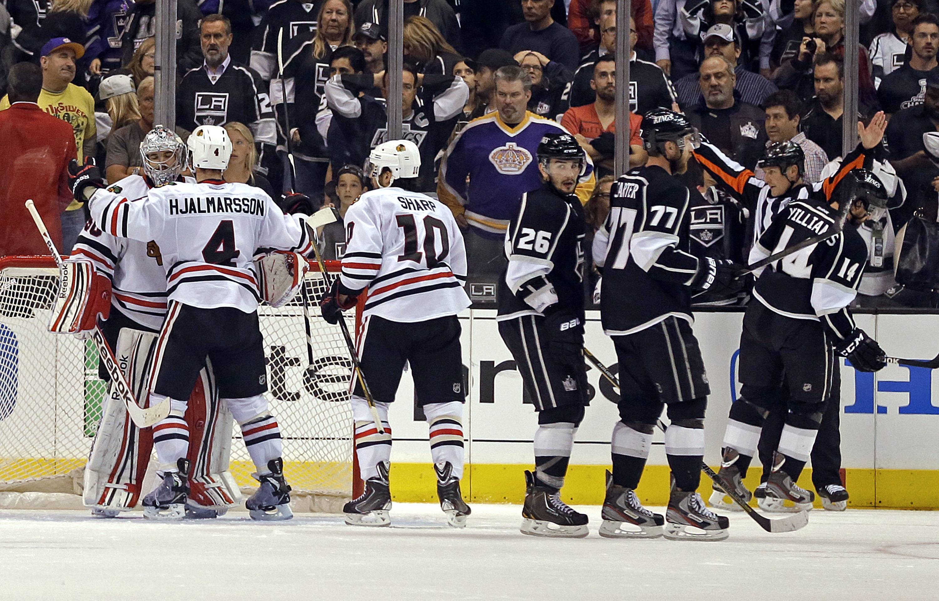The Chicago Blackhawks celebrate their 3-2 win as the Los Angeles Kings return to the bench in the third period of Game 4 of the NHL hockey Stanley Cup playoffs Western Conference finals, in Los Angeles on Thursday, June 6, 2013.