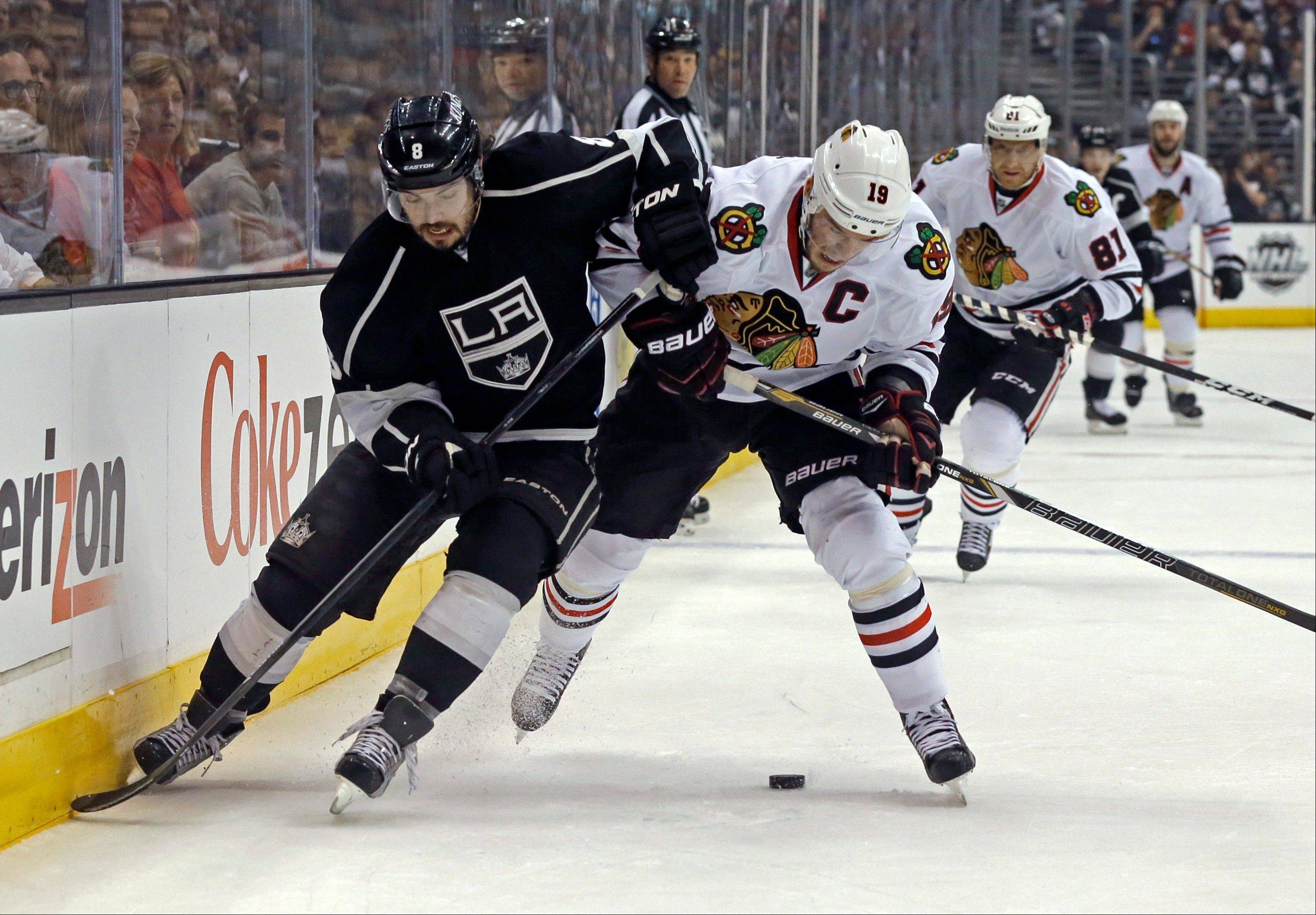 Los Angeles Kings defenseman Drew Doughty (8) and Chicago Blackhawks center Jonathan Toews (19) vie for the puck during the first period of Game 4 of the NHL hockey Stanley Cup Western Conference finals in Los Angeles on Thursday, June 6, 2013.