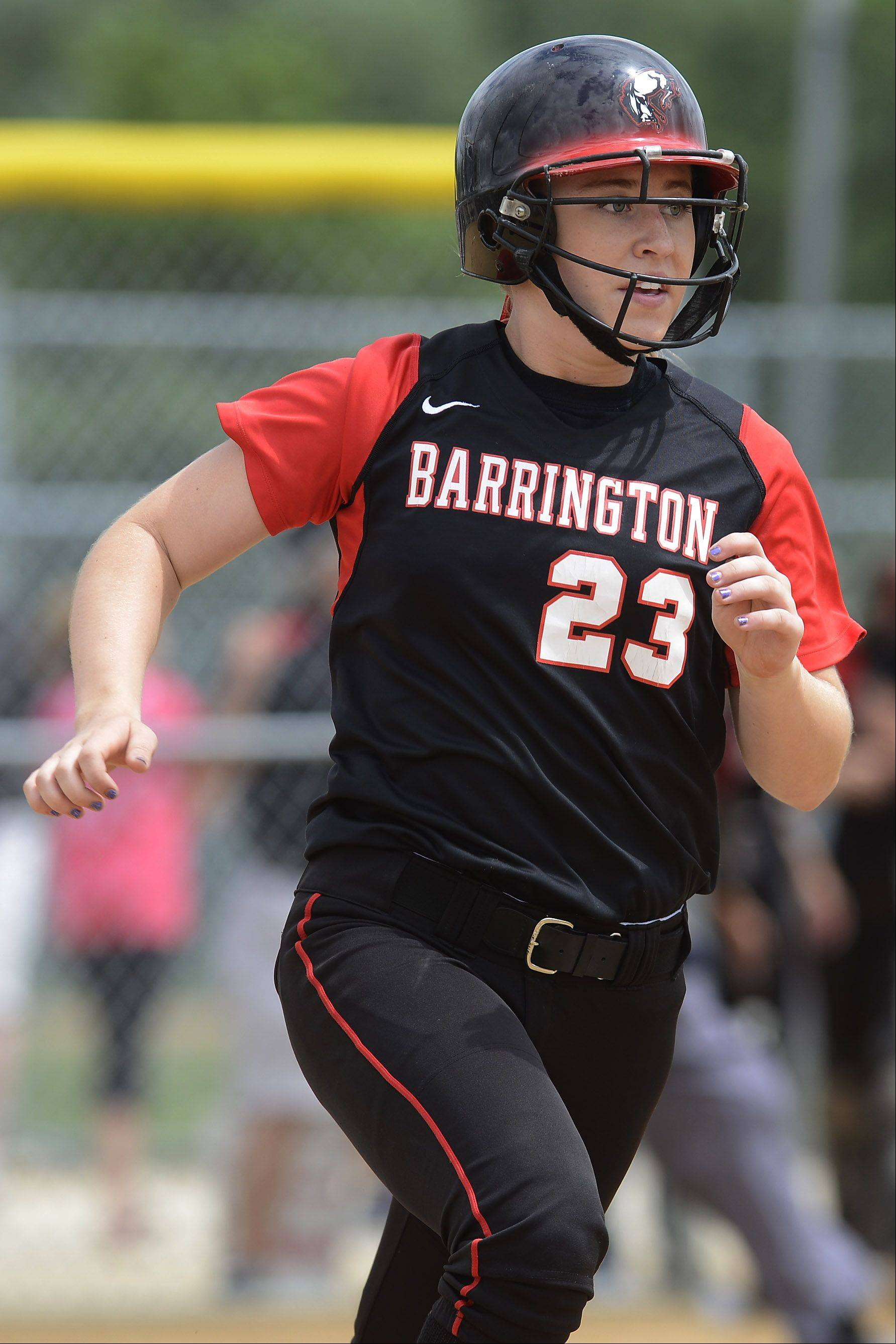 Barrington's Tess Bolger rounds first base after hitting a leadoff homer against New Trier in Rolling Meadows sectional final play.