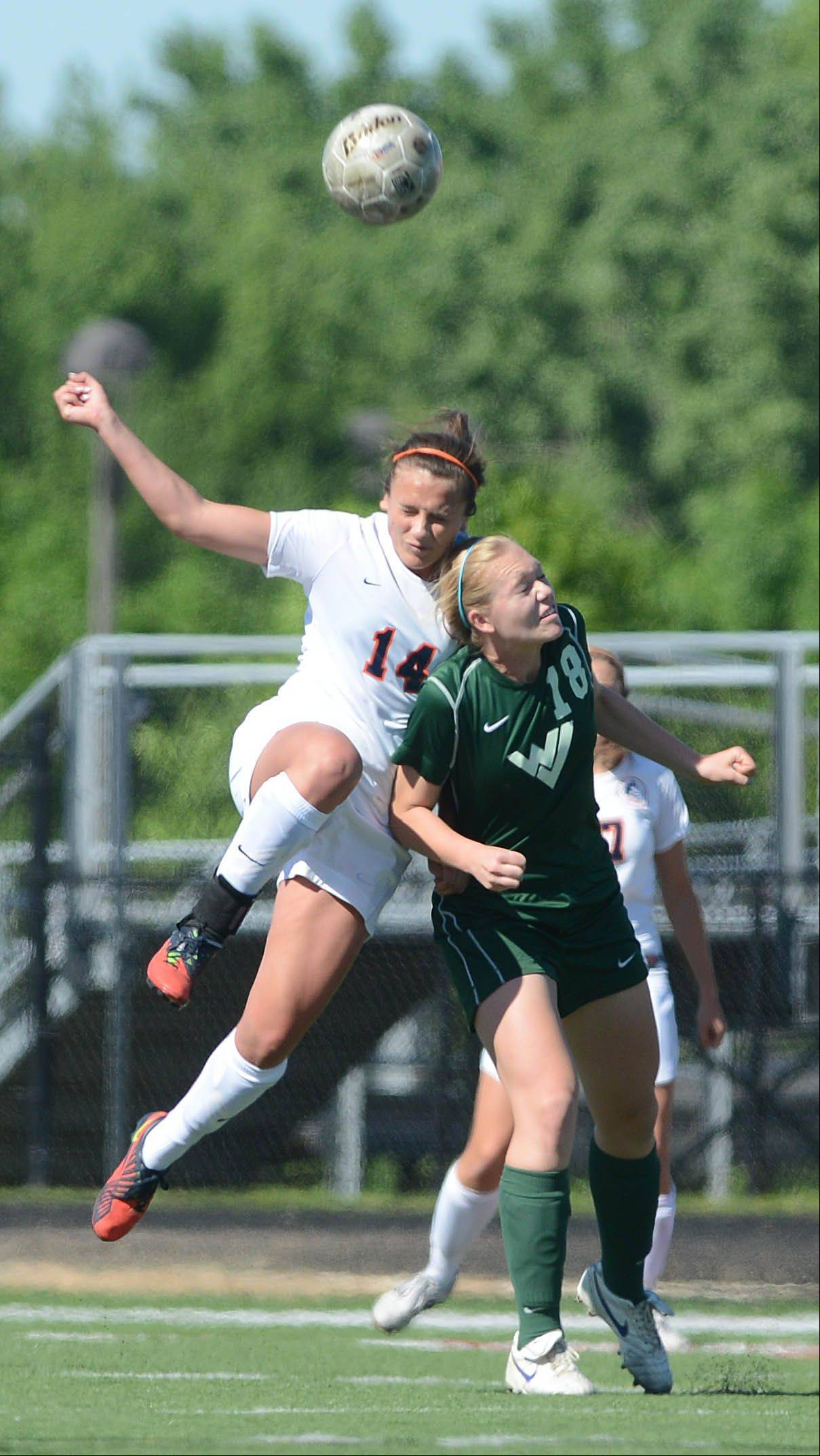 Paul Michna/pmichna@dailyherald.com ¬ Christa Szalach of Napoerville North and Morgan Kemerling of Waubonsie Valley go up for a ball during the Class 3A Bolingbrook girls soccer sectional final Friday.