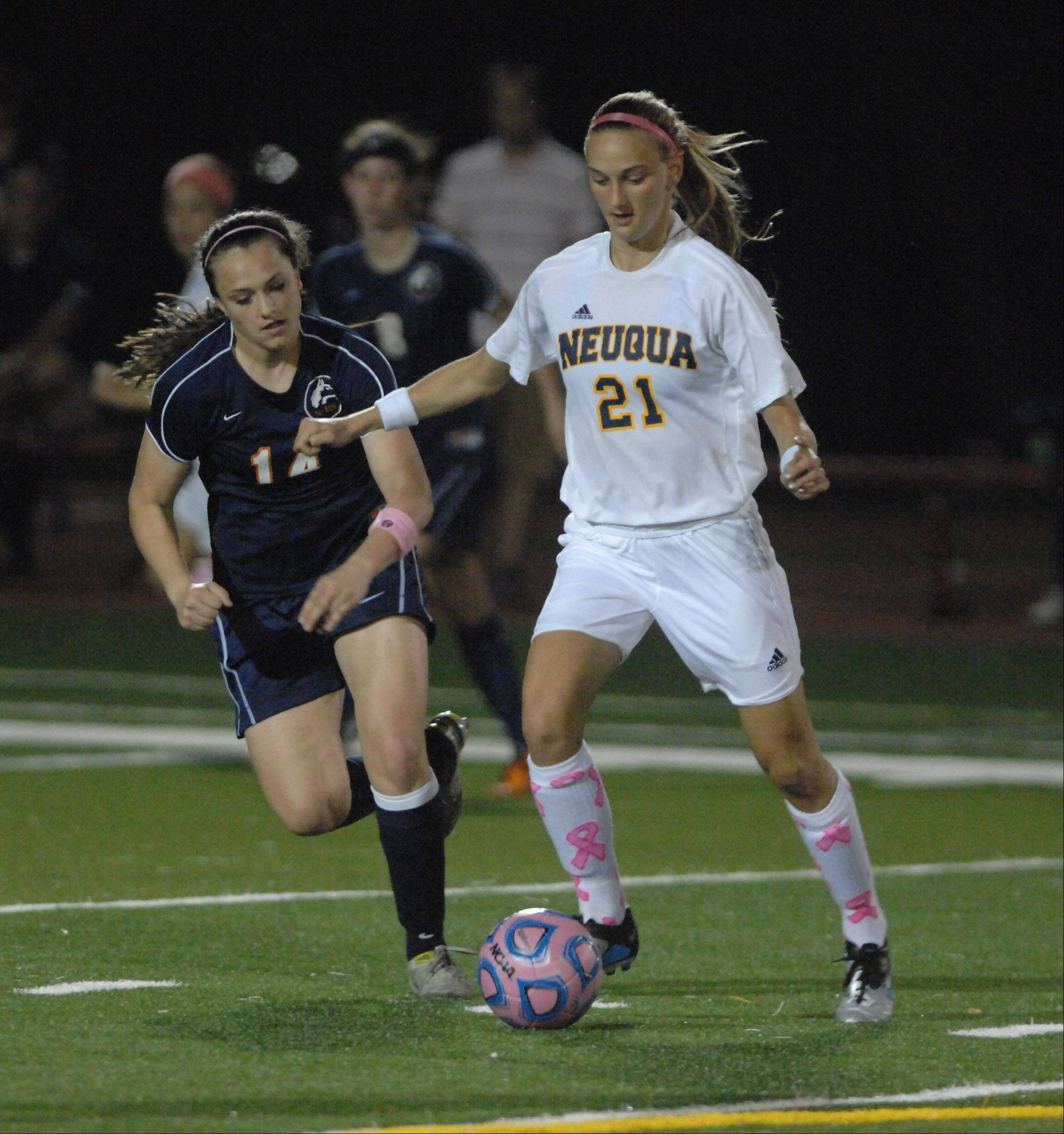 Christa Szalach of Naperville North,left.