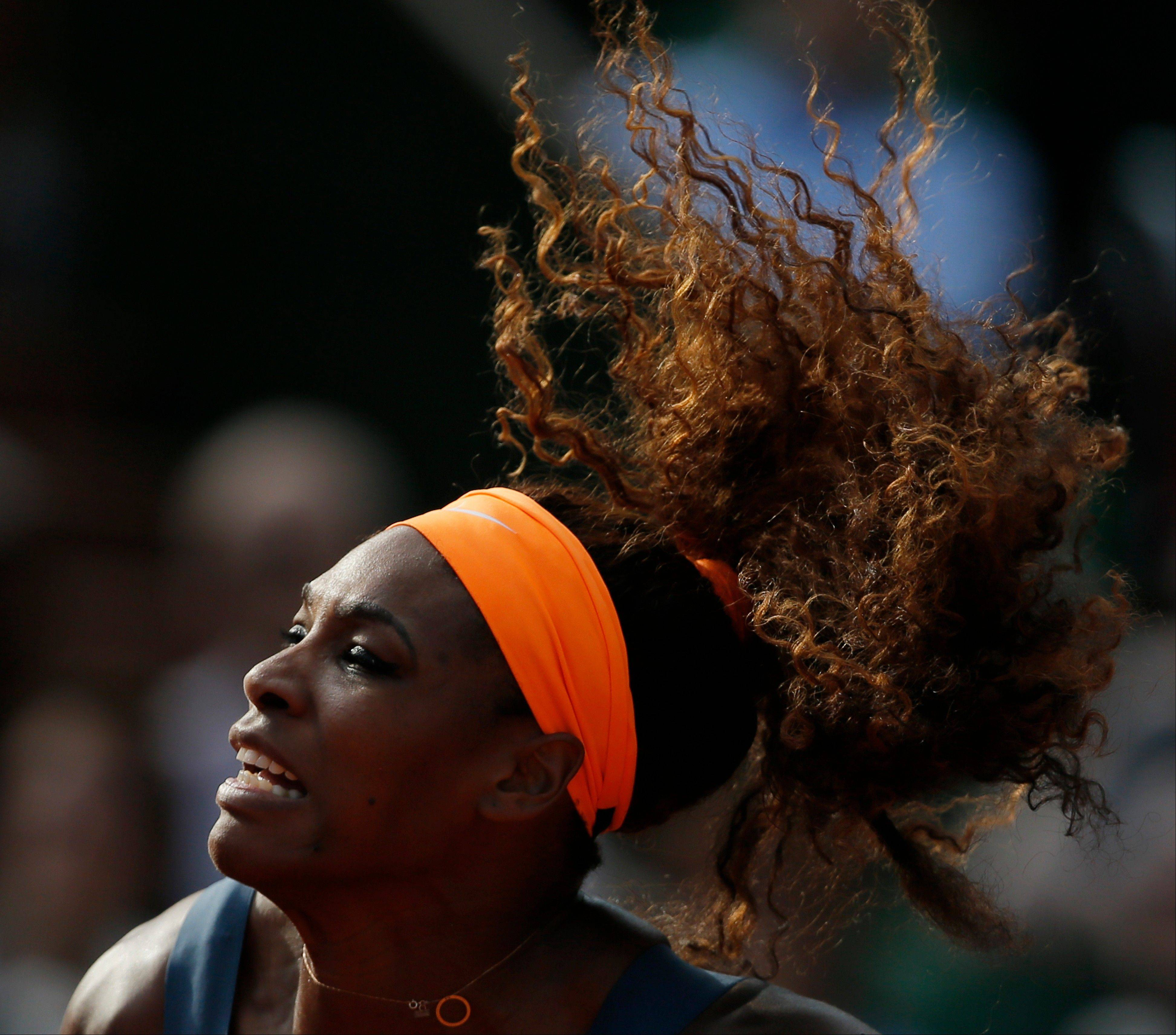 Serena Williams serves Thursday against Italy's Sara Errani, defeating Errani in two sets 6-0, 6-1, in their semifinal match at the French Open tennis tournament at Roland Garros stadium in Paris.