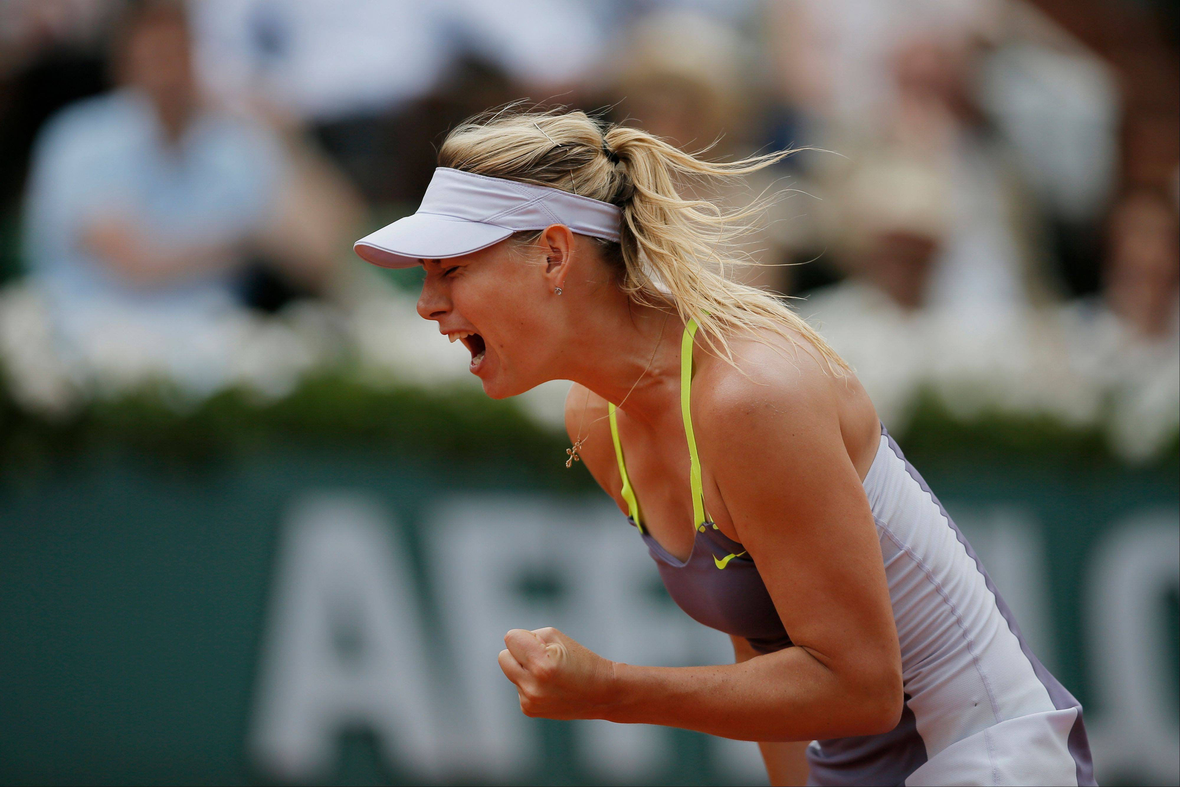 Russia's Maria Sharapova clenches her fist Thursday after scoring against Victoria Azarenka, defeating Azarenka in three sets 6-1, 2-6, 6-4, in their semifinal match at the French Open tennis tournament at Roland Garros stadium in Paris.