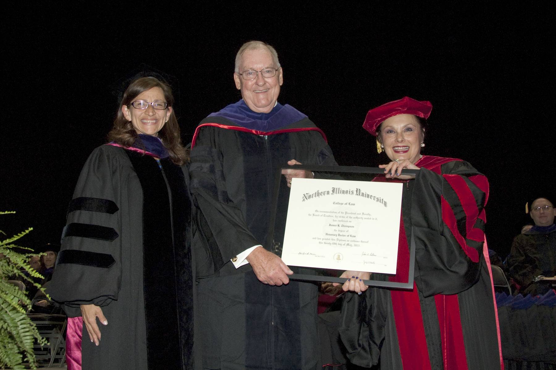 NIU Law Dean Jennifer Rosato (left) and Cherilyn Murer ('78) (right), Chair of the NIU Board of Trustees, present Governor James Thompson (center) with an honorary Doctorate of Law degree during NIU Law's Commencement ceremony.  Governor Thompson was also featured as the commencement speaker.
