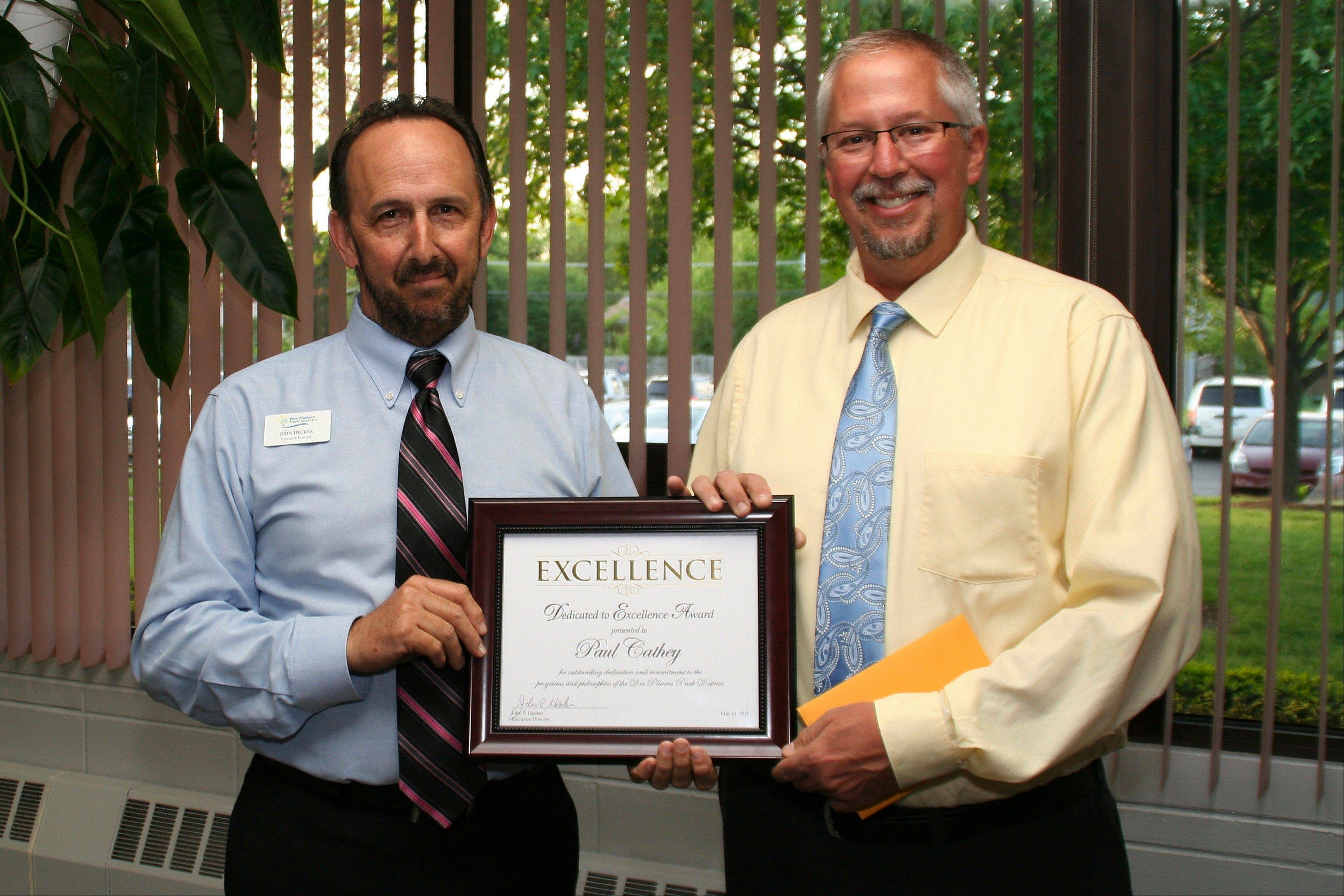 Paul Cathey receives his Dedicated to Excellence Award from Executive Director John Hecker at the Des Plaines park board meeting on May 21.