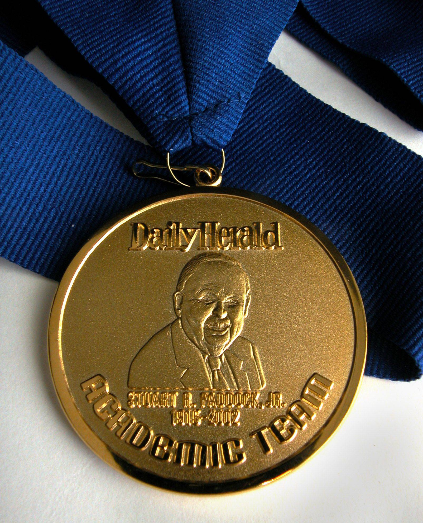 The Academic Team medallion, featuring the likeness of Stuart R. Paddock Jr., is won by each member.