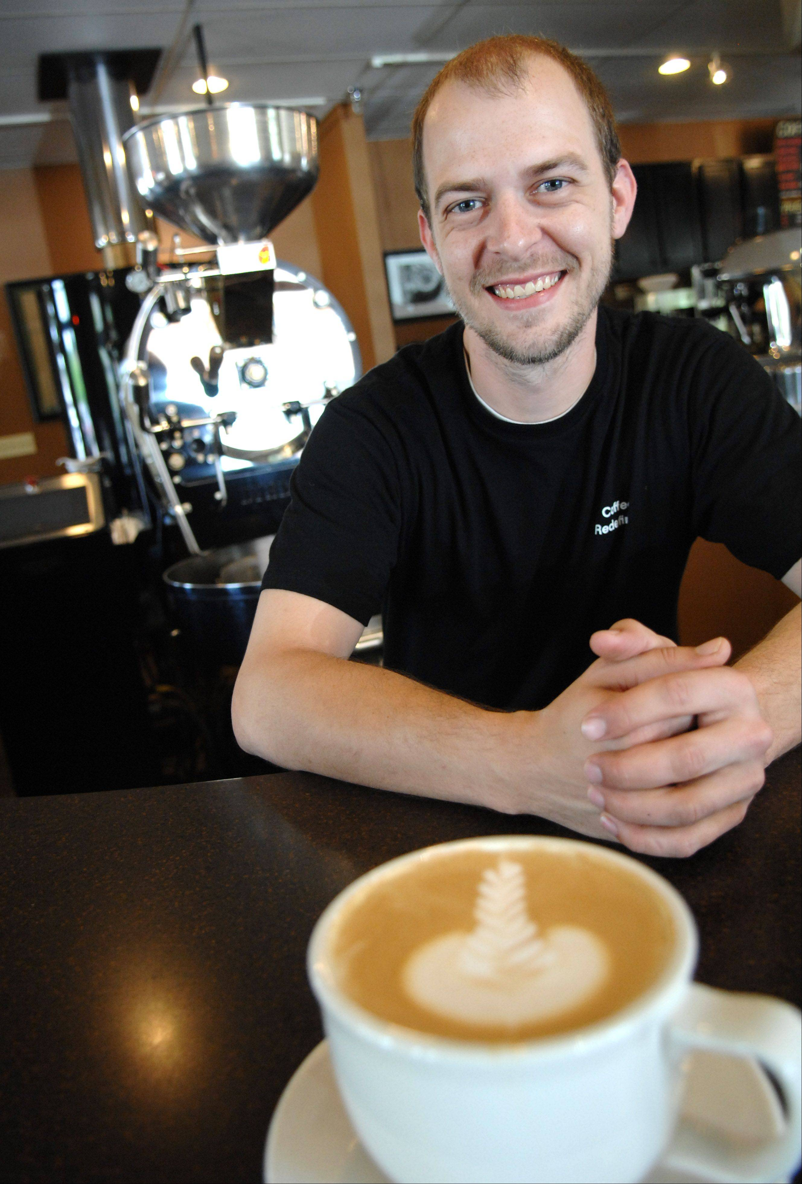 Barista Michael Burkholder of Arcedium Coffeehouse in St. Charles is proud of his coffeehouse's top eight finish in regional competition.
