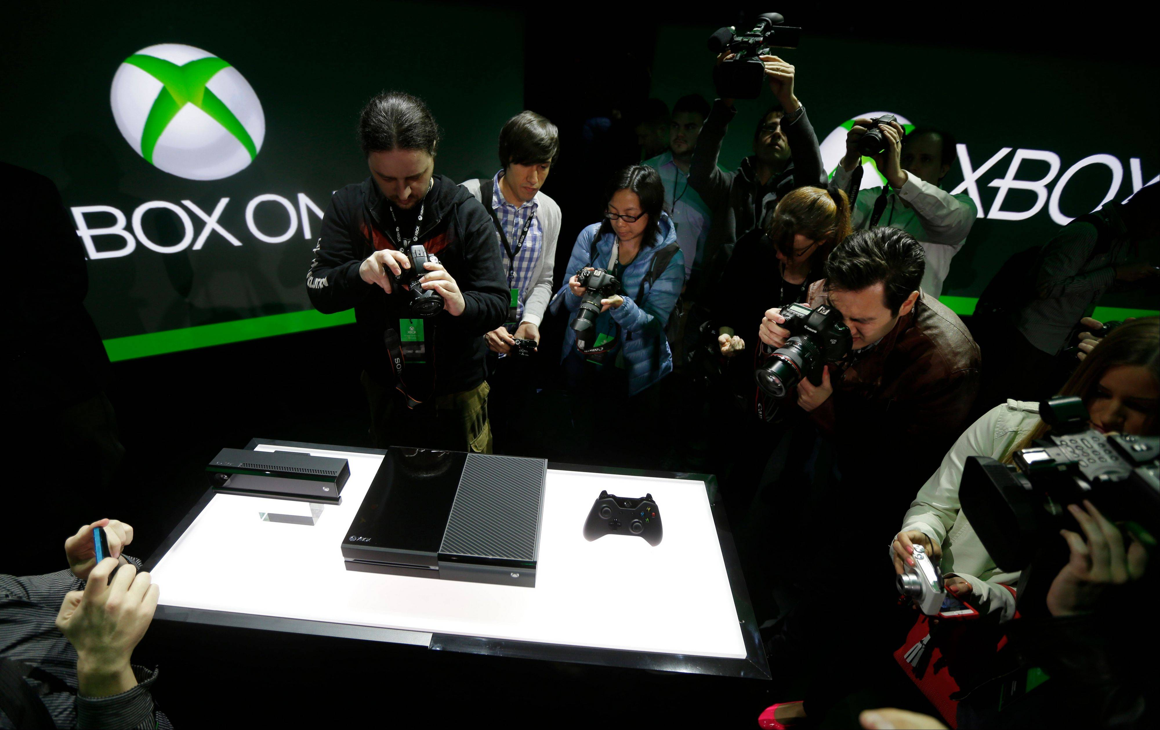 Photographers crowd around Microsoft Corp.'s next-generation Xbox One entertainment and gaming console system after it was officially revealed.