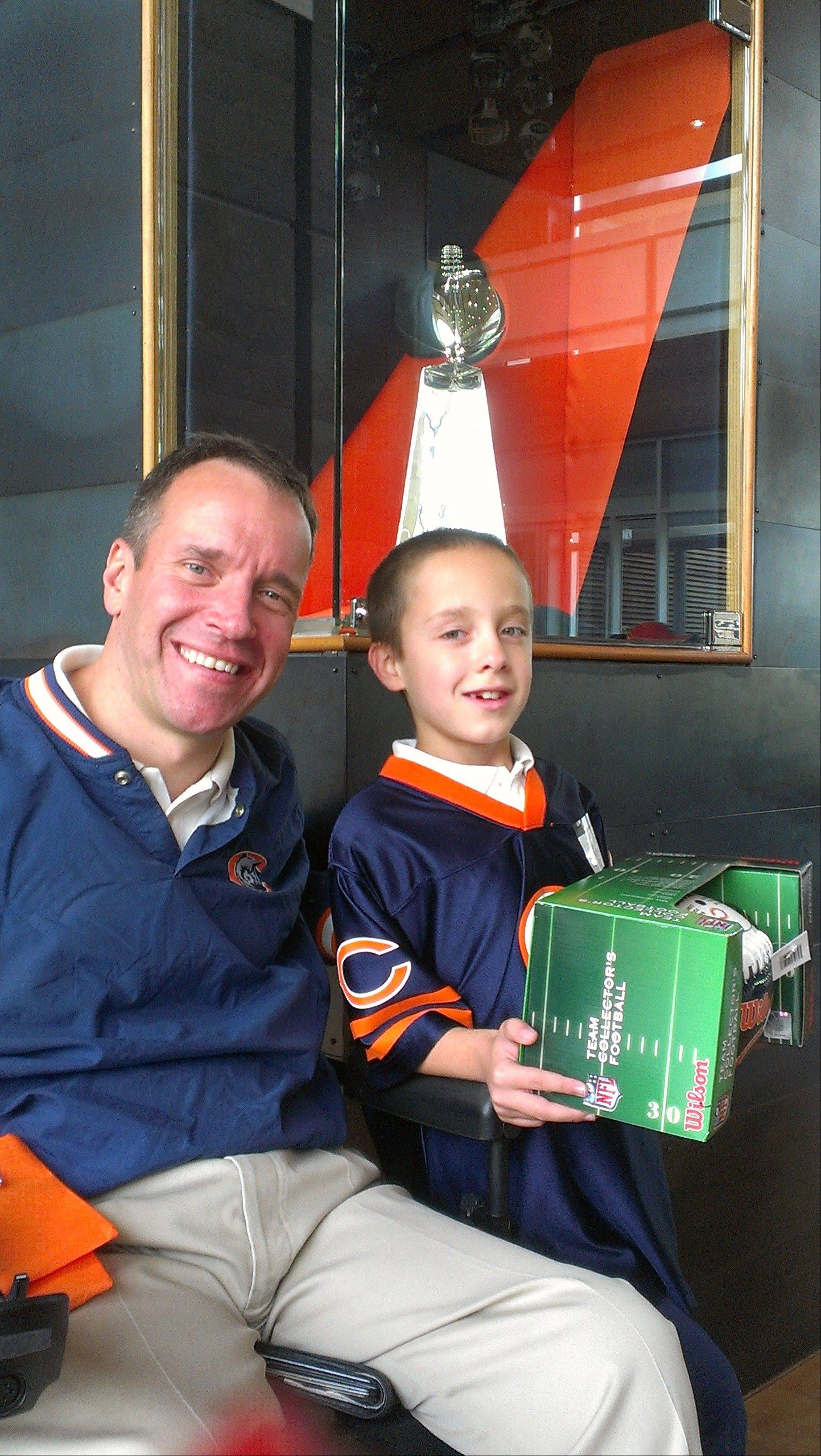 "Gridiron Alliance board member Steve Herbst of Palatine is shown with his son, Jack. Herbst was one of three winners nationwide of the National Mobility Equipment Dealers Association's ""Local Hero"" contest."