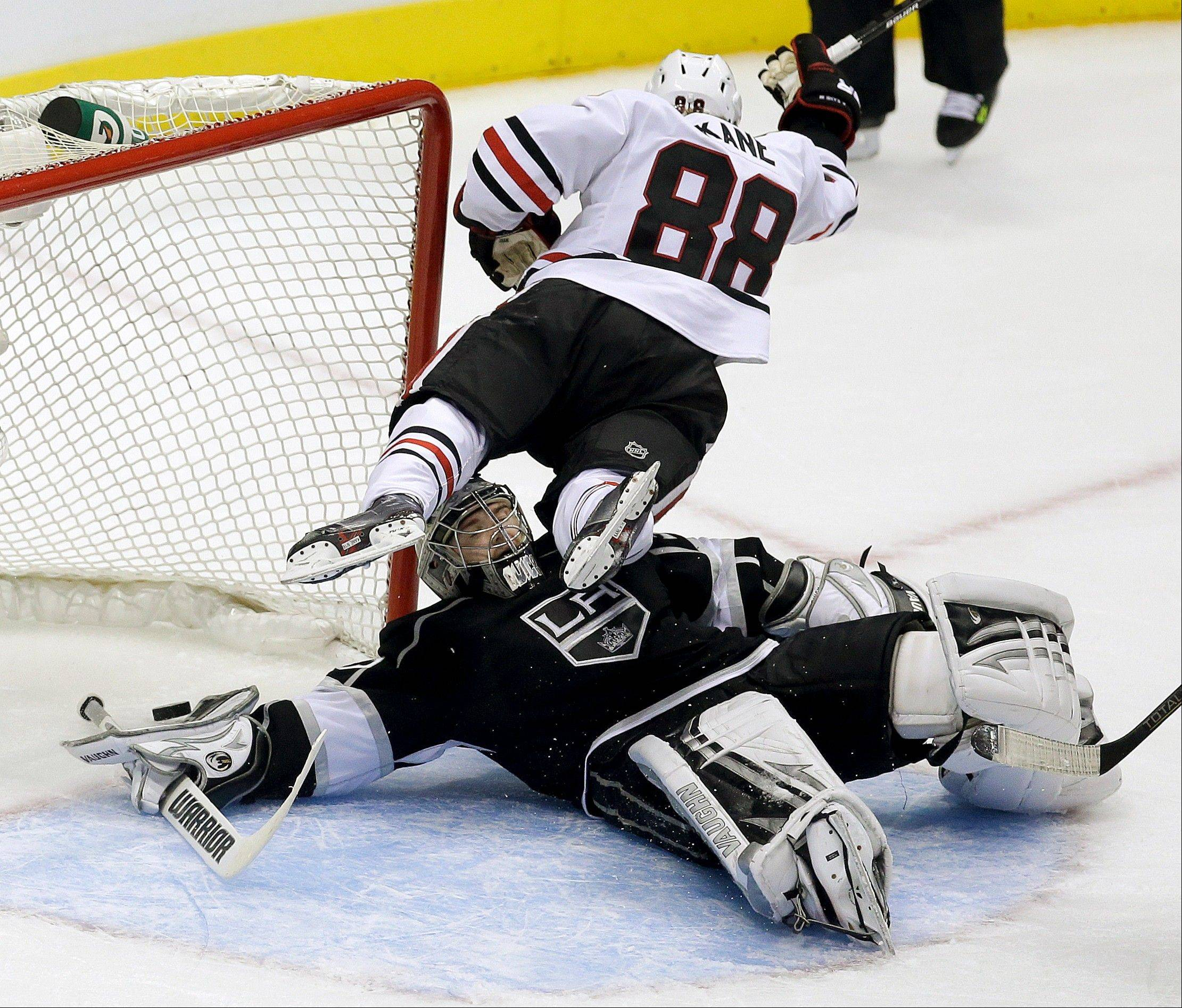 Chicago Blackhawks right wing Patrick Kane scores past Los Angeles Kings goalie Jonathan Quick during the second period in Game 4 of the NHL hockey Stanley Cup playoffs Western Conference finals, in Los Angeles on Thursday, June 6, 2013. (AP Photo/Chris Carlson)
