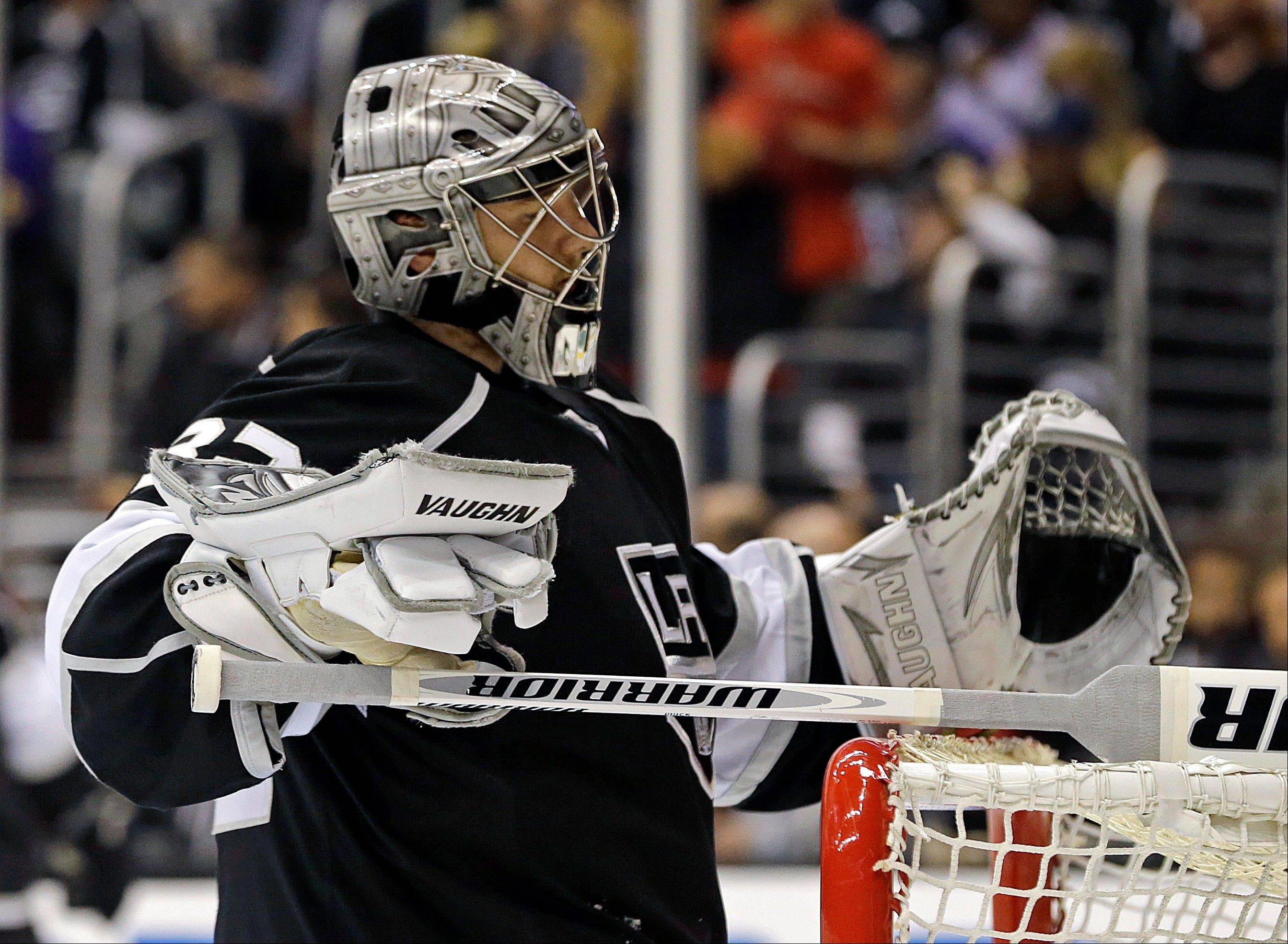 Kings goalie Jonathan Quick waits after a goal by the Chicago Blackhawks in the third period of Game 4 of the NHL hockey Stanley Cup playoffs Western Conference finals, in Los Angeles Thursday, June 6, 2013. The Blackhawks won 3-2.