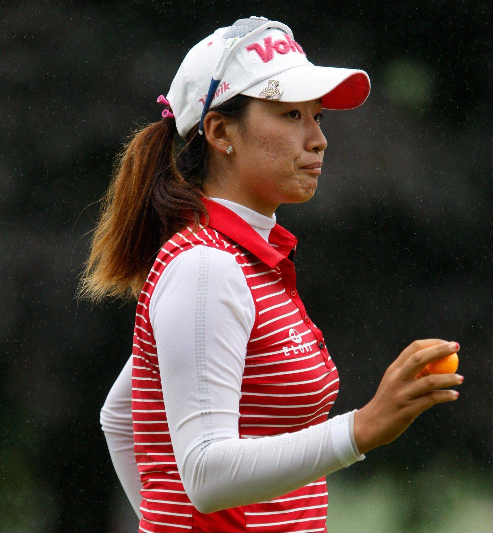 Chella Choi waves after her birdie on the 10th hole during the first round LPGA Championship golf championship, Friday, June 7, 20123, in Pittsford, N.Y. (AP Photo/Democrat & Chronicle, Shawn Dowd) MAGS OUT; NO SALES