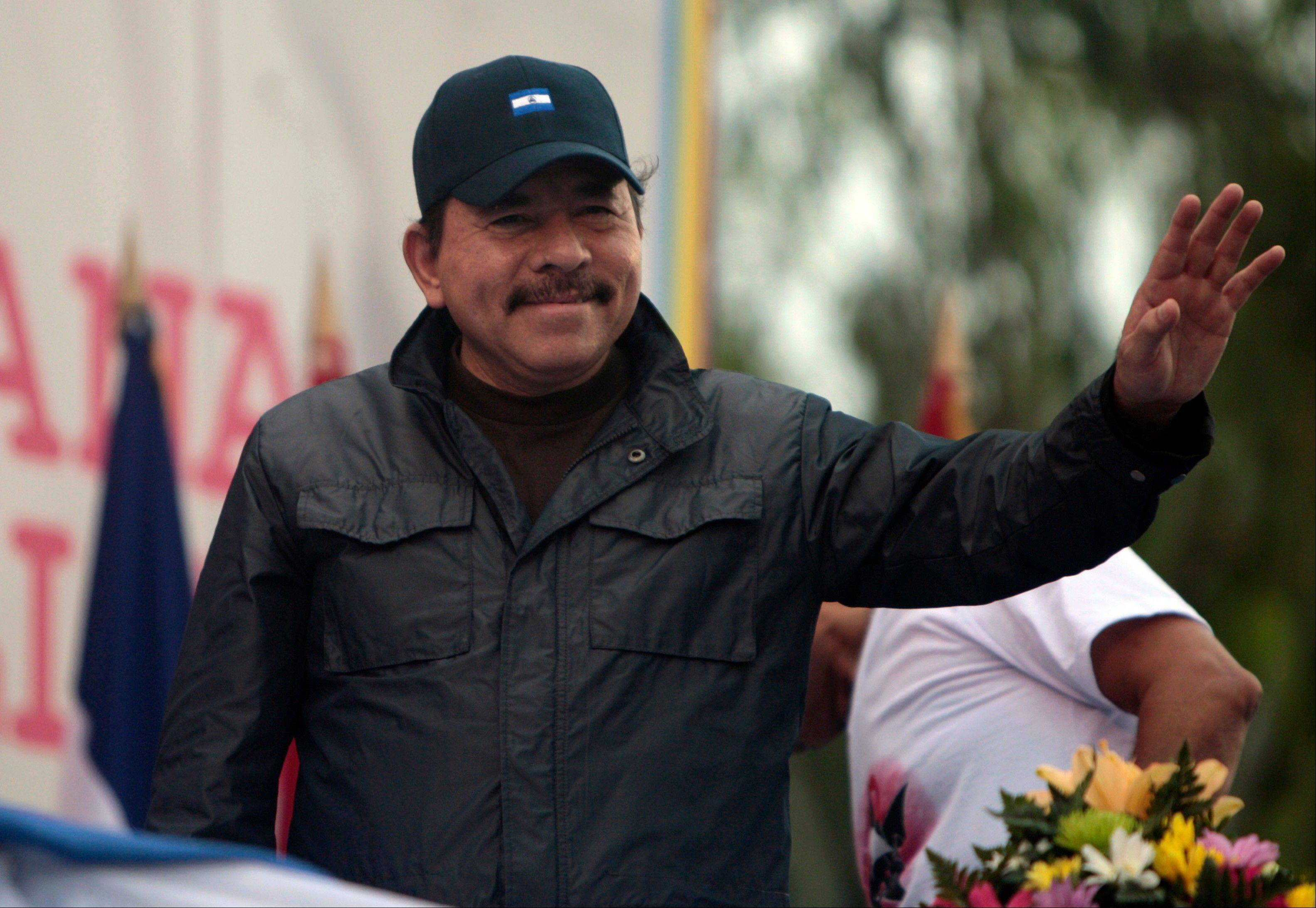 Nicaragua's President Daniel Ortega waves to supporters during an event marking the 32nd anniversary of the Sandinista's withdrawal to Masaya, in Managua, Nicaragua.