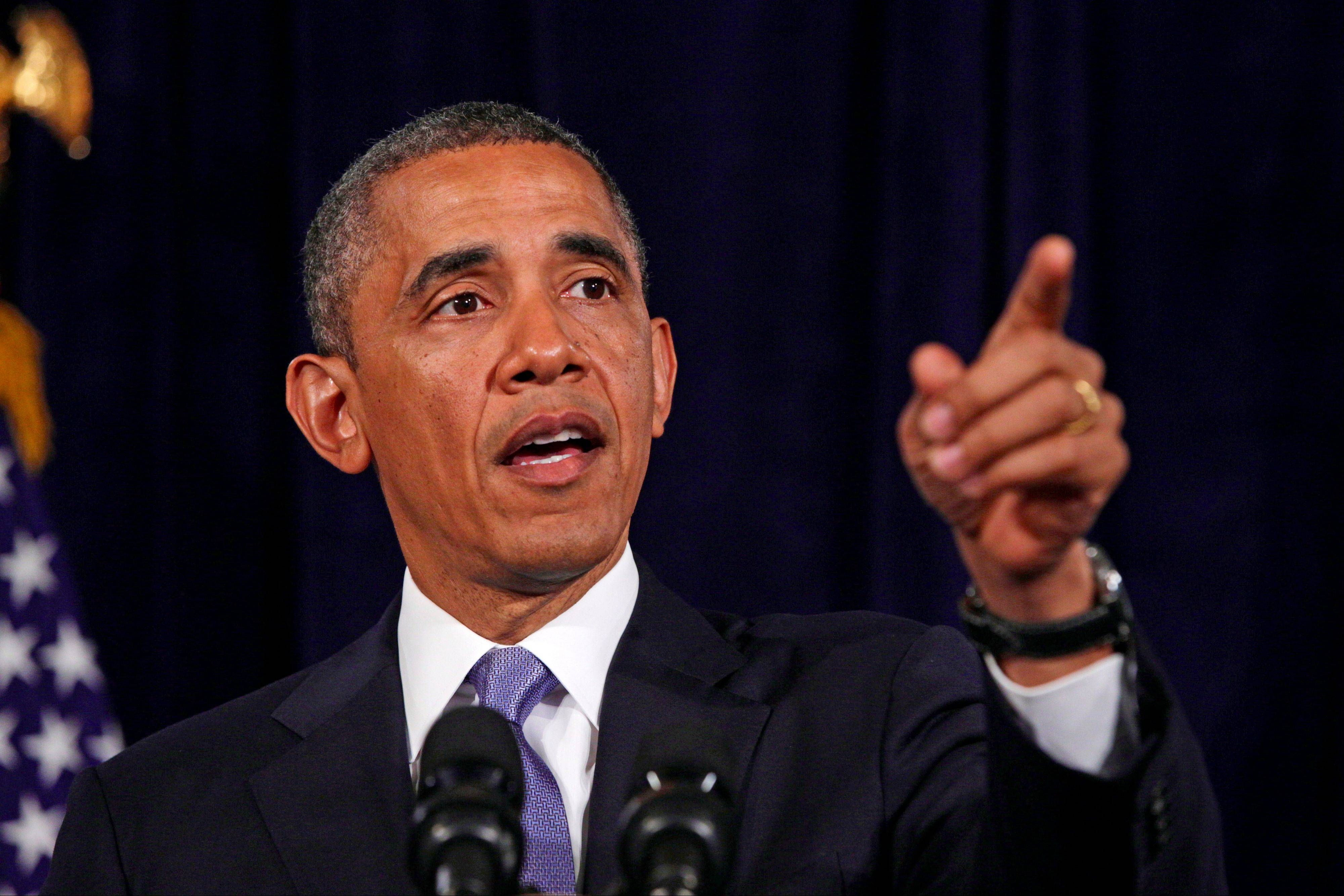 President Barack Obama gestures Friday about the Affordable Care Act in San Jose, Calif.
