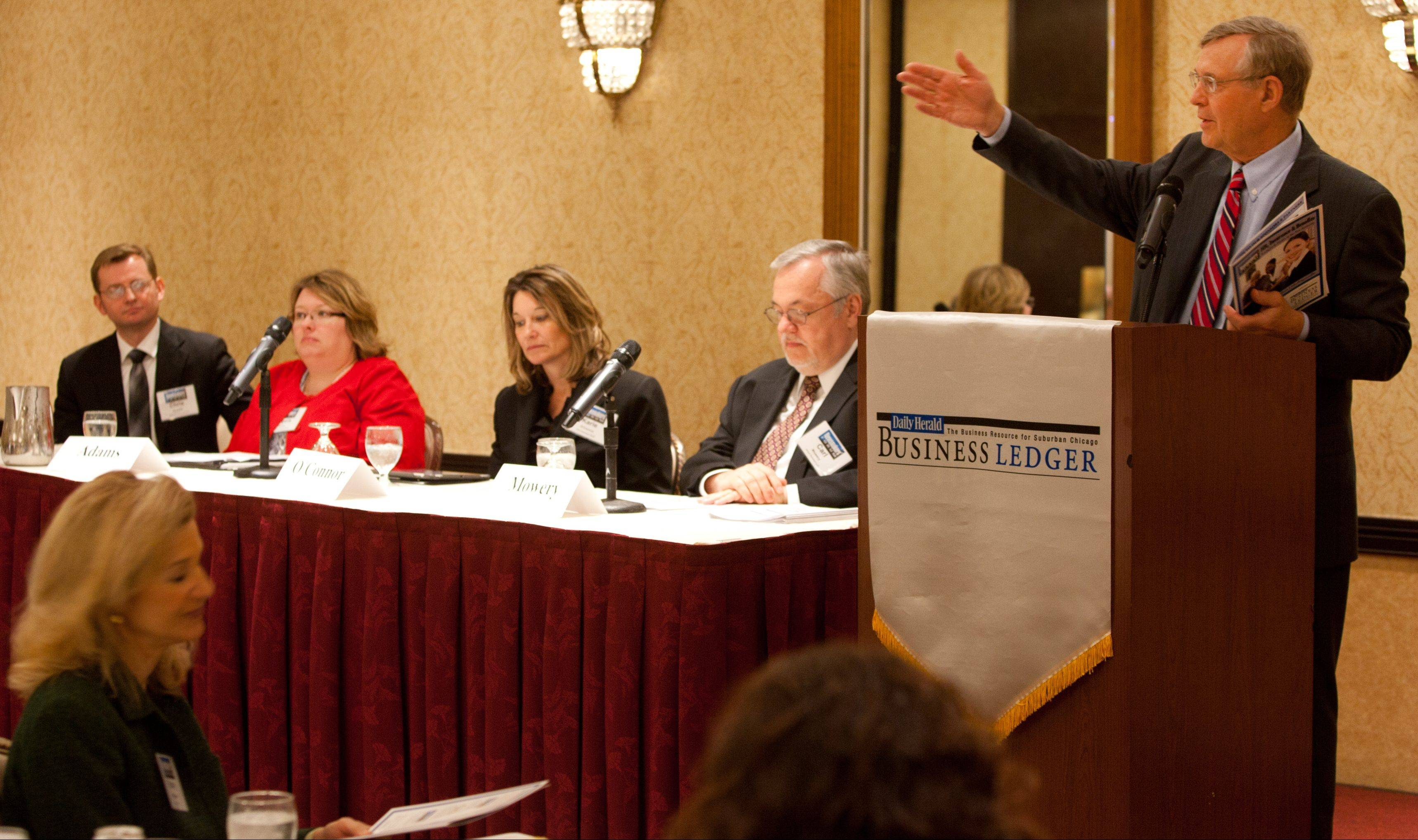 Jim Elsener, manager of business development for the Daily Herald Business Ledger, introduces the Newsmakers Forum panel at the Lisle/Naperville Hilton on Thursday.