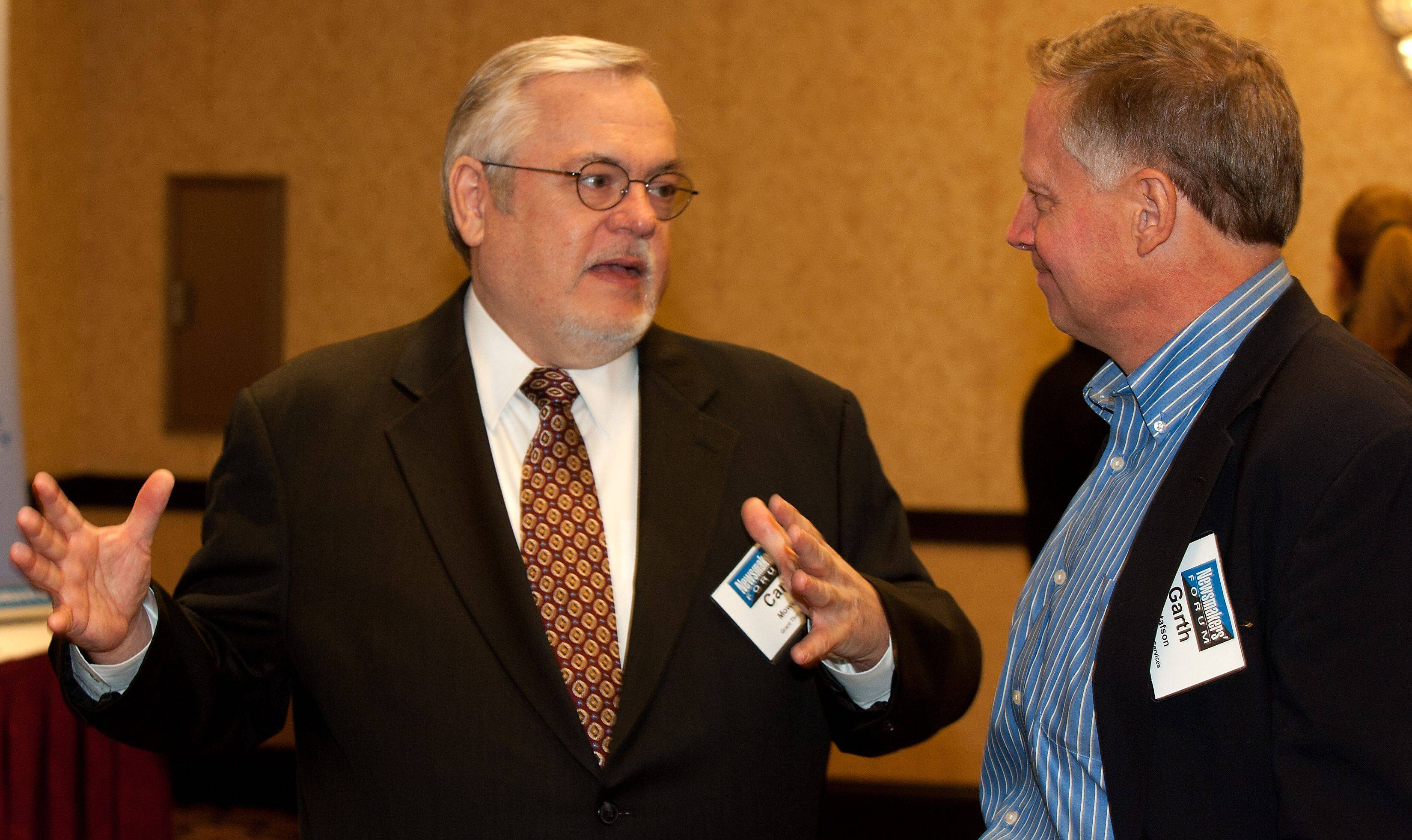 Panelist Carl Mowery of Grant Thornton LLP, left, talks with Garth Gustafson, right, of Plexus Groupe in Deer Park, before the Business Ledger Newsmakers Forum.