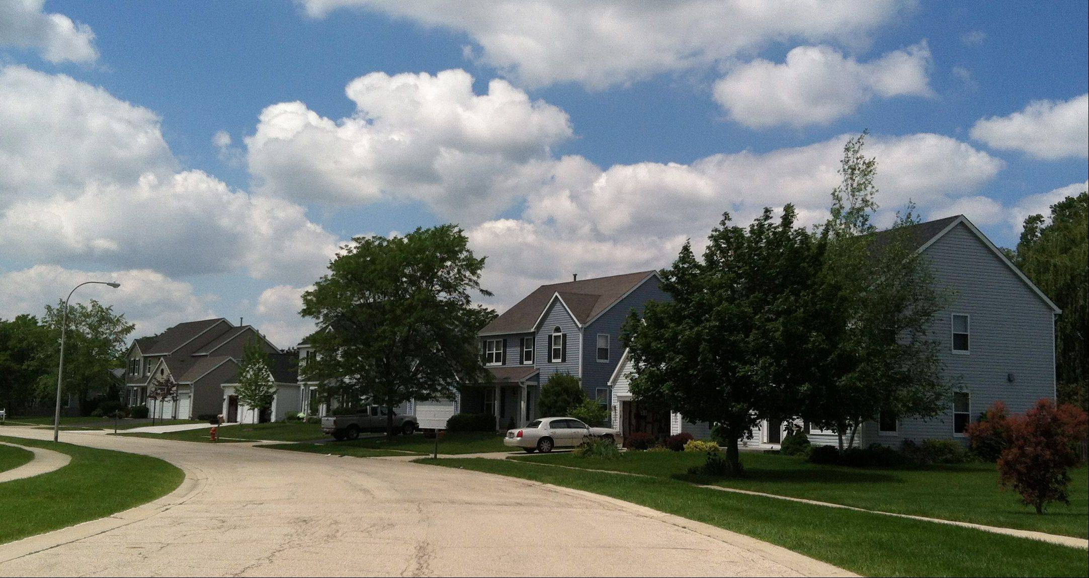 These houses along Cottonwood Drive are typical of those found in the Woodbridge South subdivision.