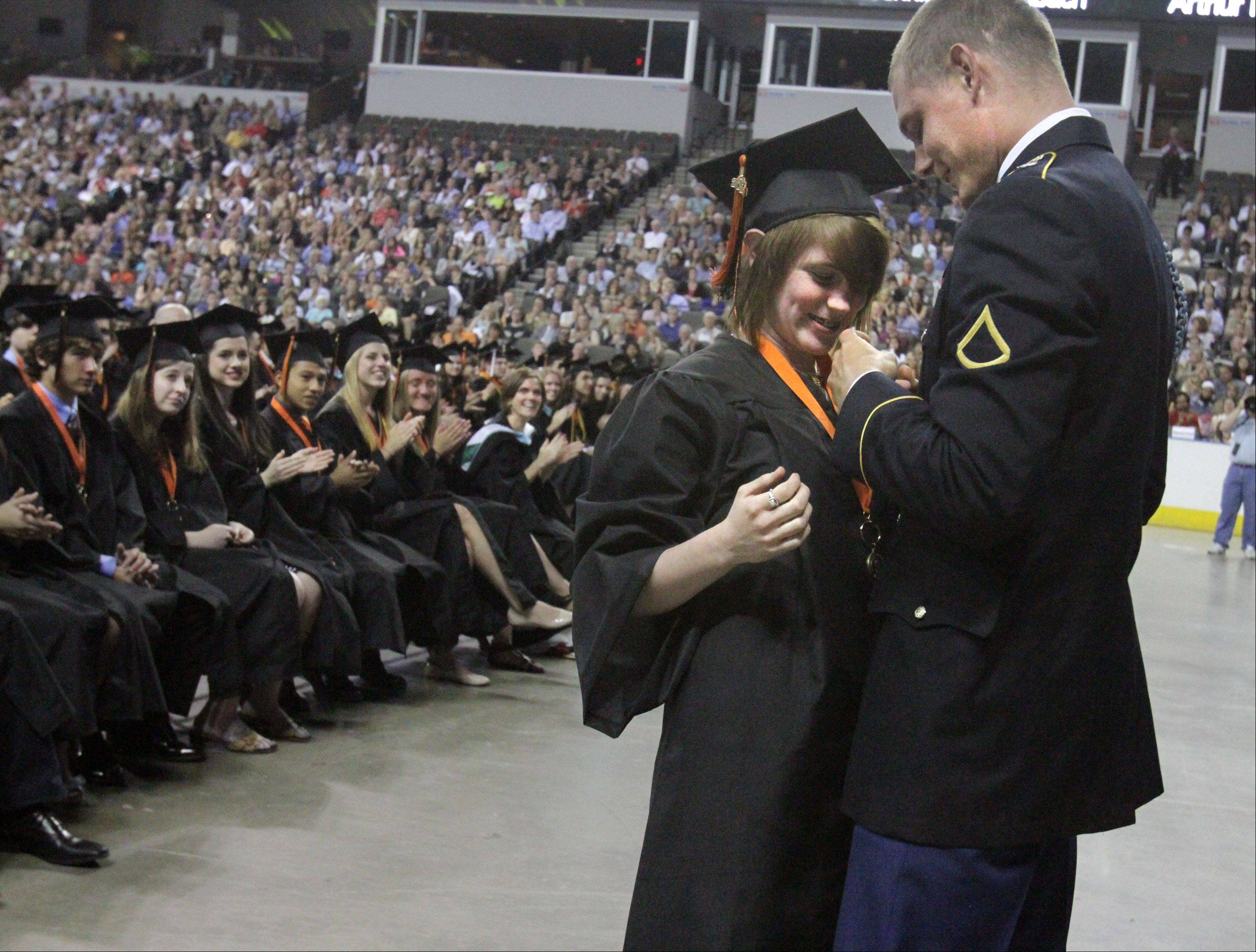 Libertyville High School graduate Stephanie Allen is surprised during the middle of the school's graduation ceremony by her brother 2011 graduate, PFC David Allen who is stationed at Fort Bliss in El Paso, Texas on Friday, June 7 at the Sears Centre in Hoffman Estates.