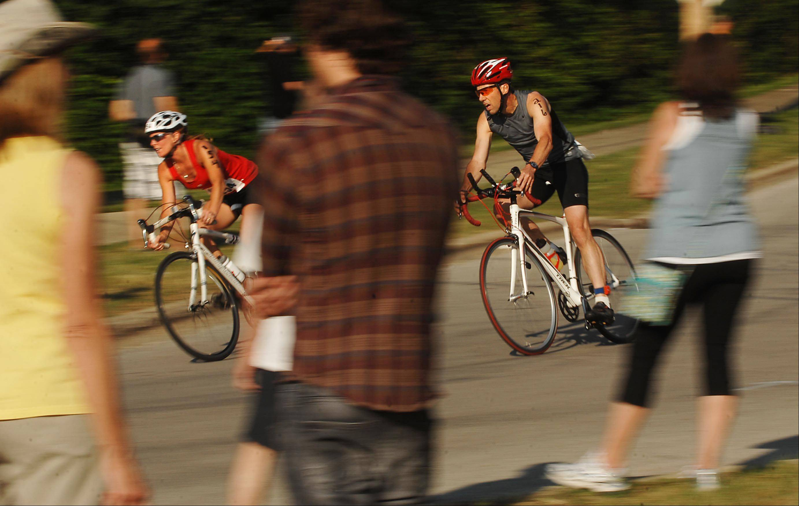 Racers approach the finish of the 14-mile bike ride portion of last year's Batavia Triathlon and Duathlon. Entrants finished with a 4-mile run.