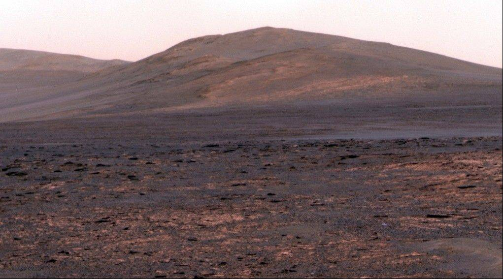 "This image provided by NASA shows a panoramic view from NASA's Mars Exploration rover Opportunity of ""Solander Point."""