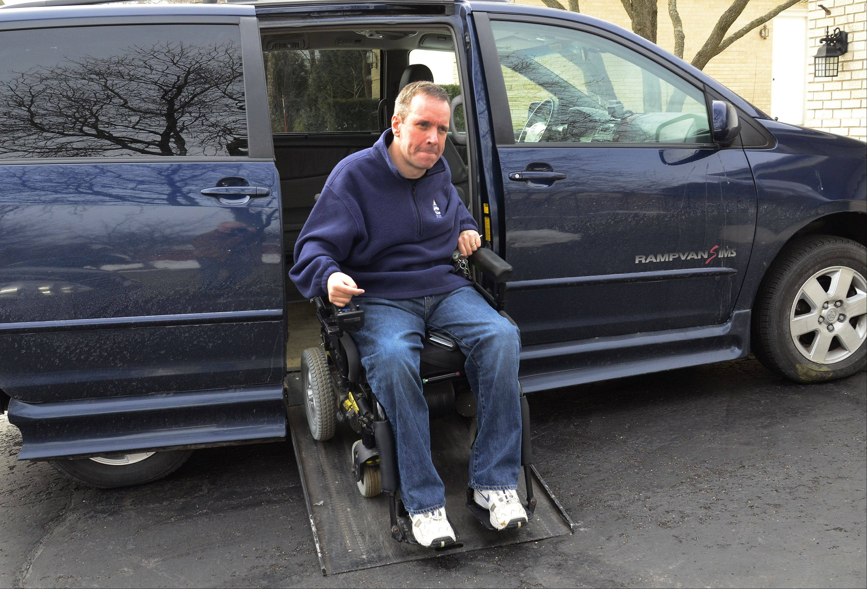 "Steve Herbst of Palatine was one of three winners nationwide of the National Mobility Equipment Dealers Association's ""Local Hero"" contest for a new wheelchair-accessible van. Here Herbst is with his current vehicle."