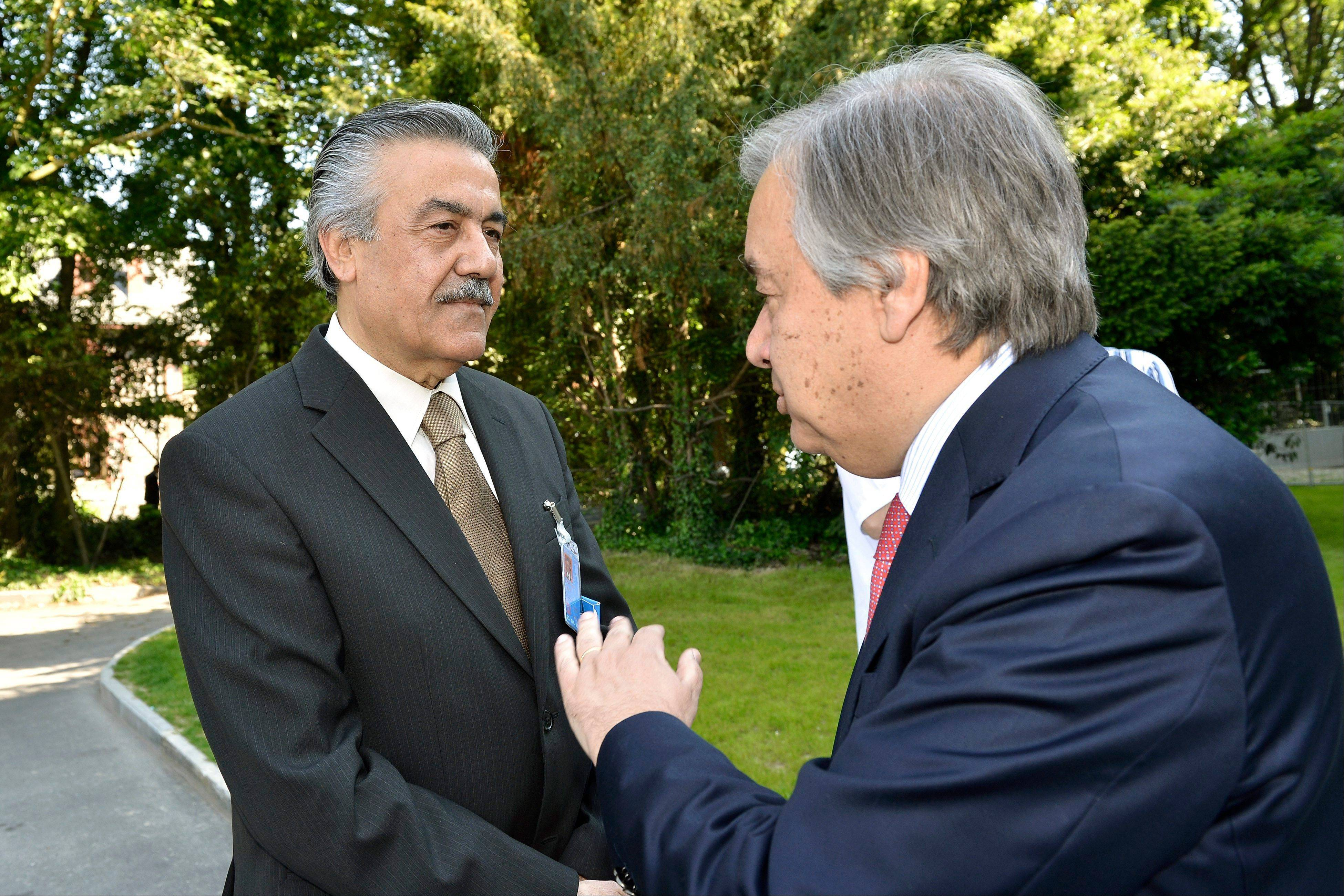 Faysal Khabbaz Hamoui, left, Ambassador of the Permanent Representative Mission of Syria to Geneva, speaks Friday with Antonio Guterres, right, United Nations High Commissioner for Refugees, before a meeting for the launch of the Regional Response Plan for Syrian Refugees and Syrian Humanitarian Assistance Response Plan at the World Trade Organization headquarters in Geneva, Switzerland.