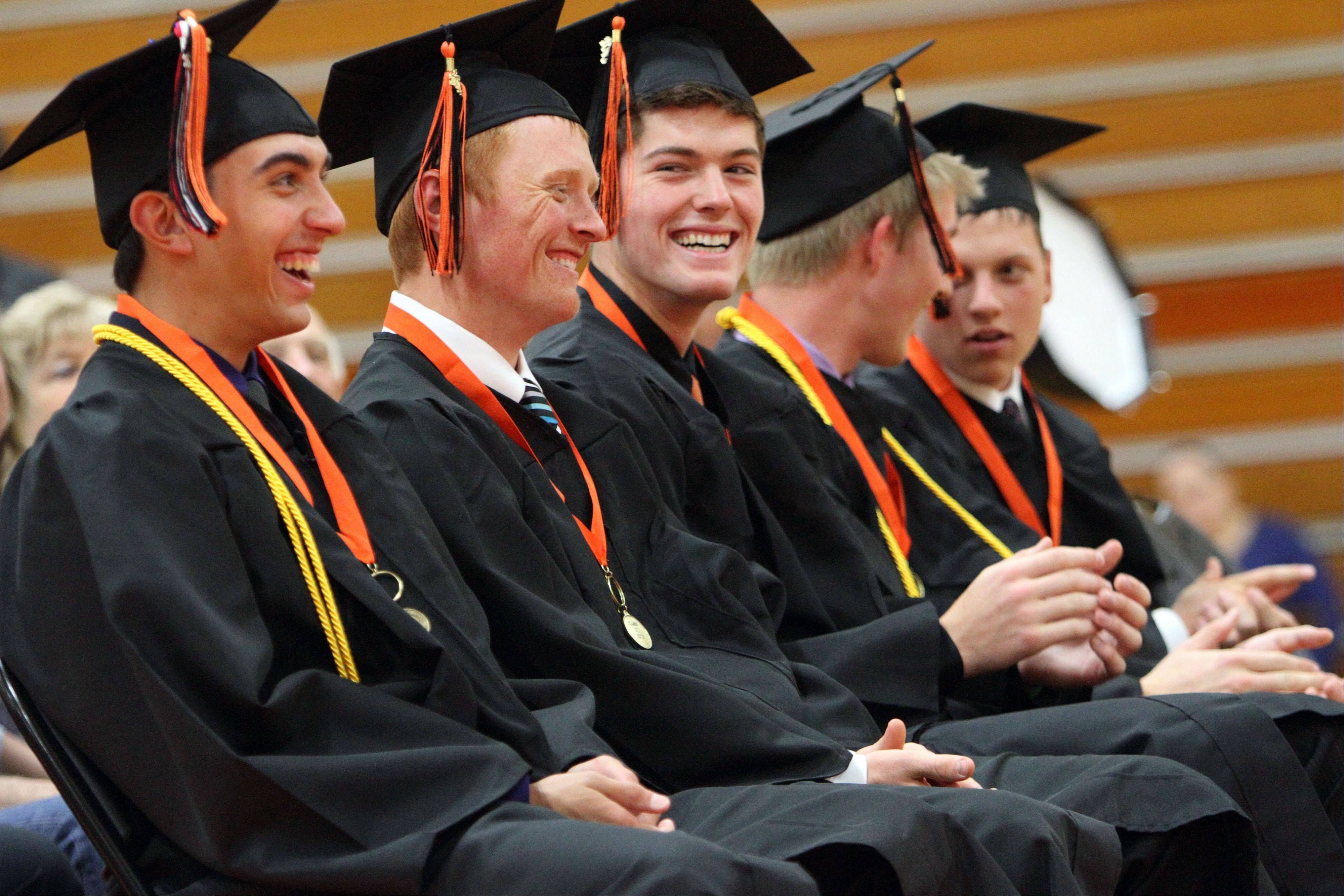 Ten Libertyville High School seniors on the baseball team participate in a special graduation ceremony in the gymnasium Thursday. The team's state semifinal game against St. Charles East High School conflicts with the school's graduation ceremony this evening.