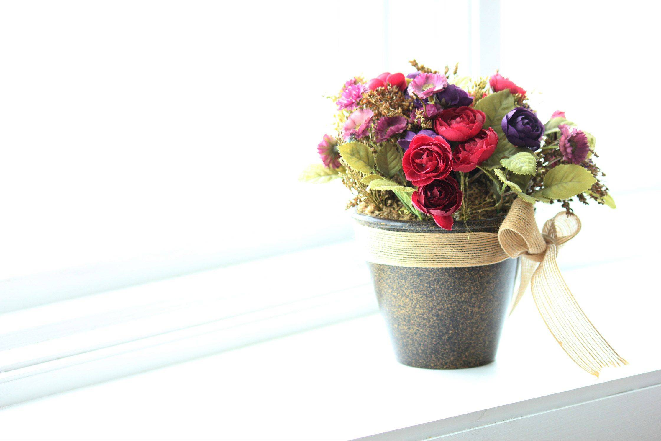 Artificial flowers on the window sill in Wildwood on February 23rd.