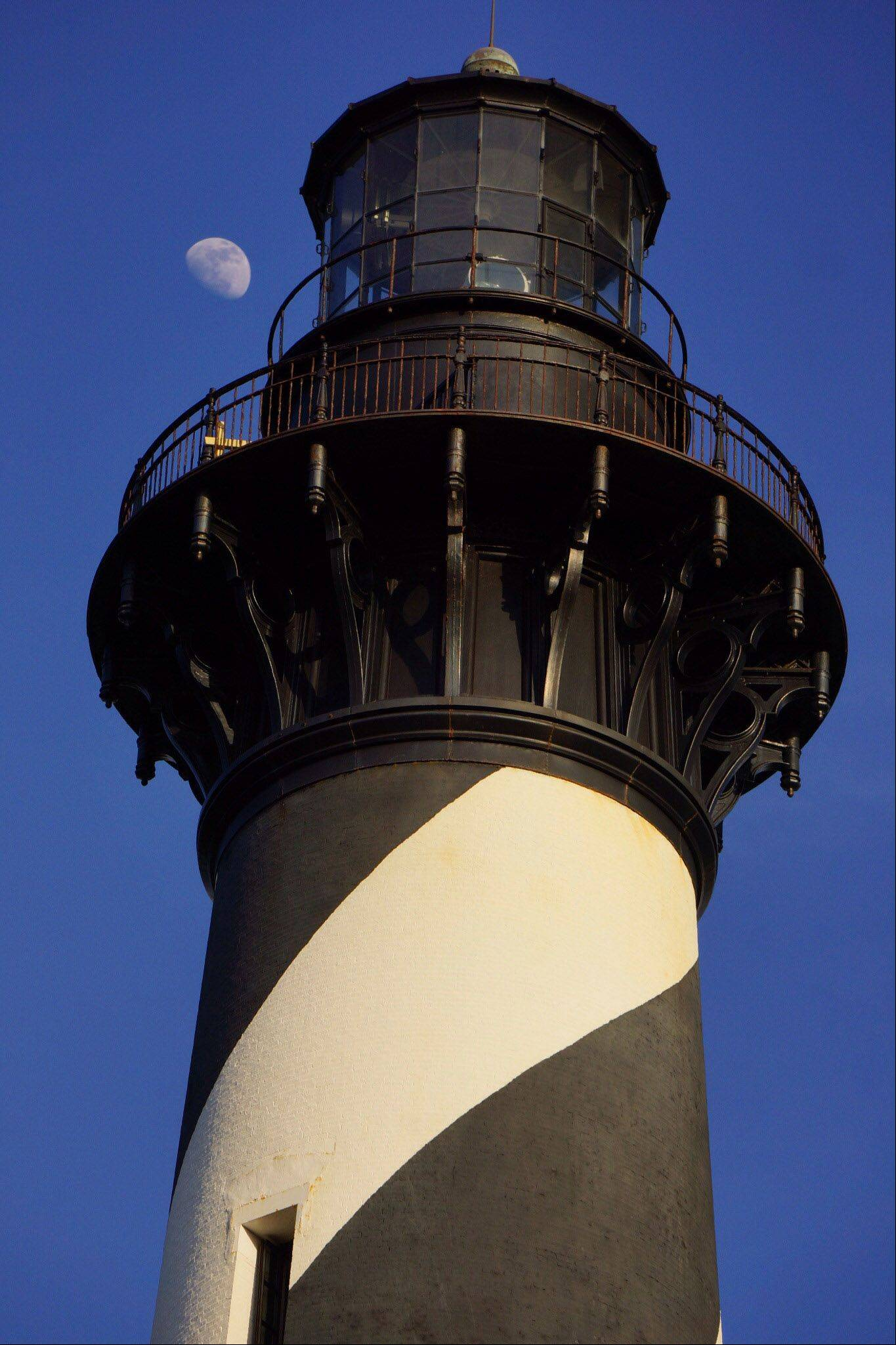 On our recent trip to The Outer Banks, North Carolina, this photo brought together two common sailor beacons: a half-moon rising behind the Cape Hatteras Lighthouse.