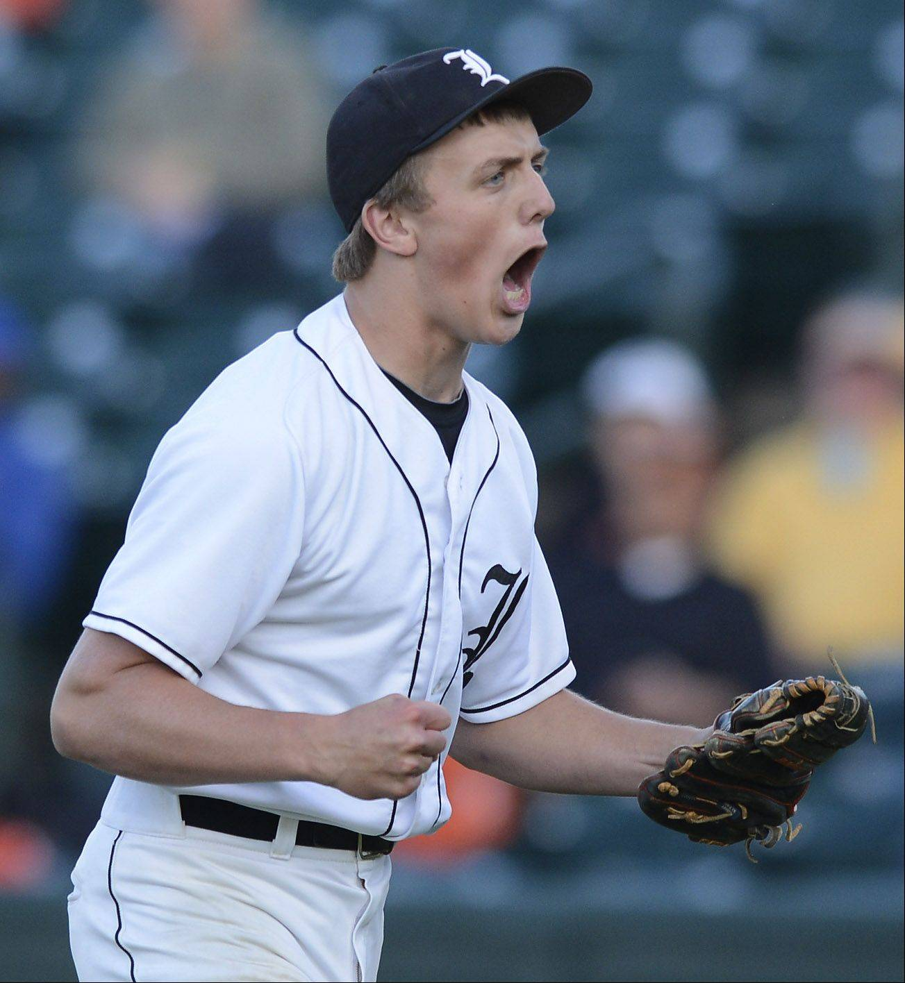 Libertyville pitcher Kevin Calamari celebrates after closing his team's 9-6 victory over St. Charles East during the Class 4A state baseball semifinals at Silver Cross Field in Joliet Friday.