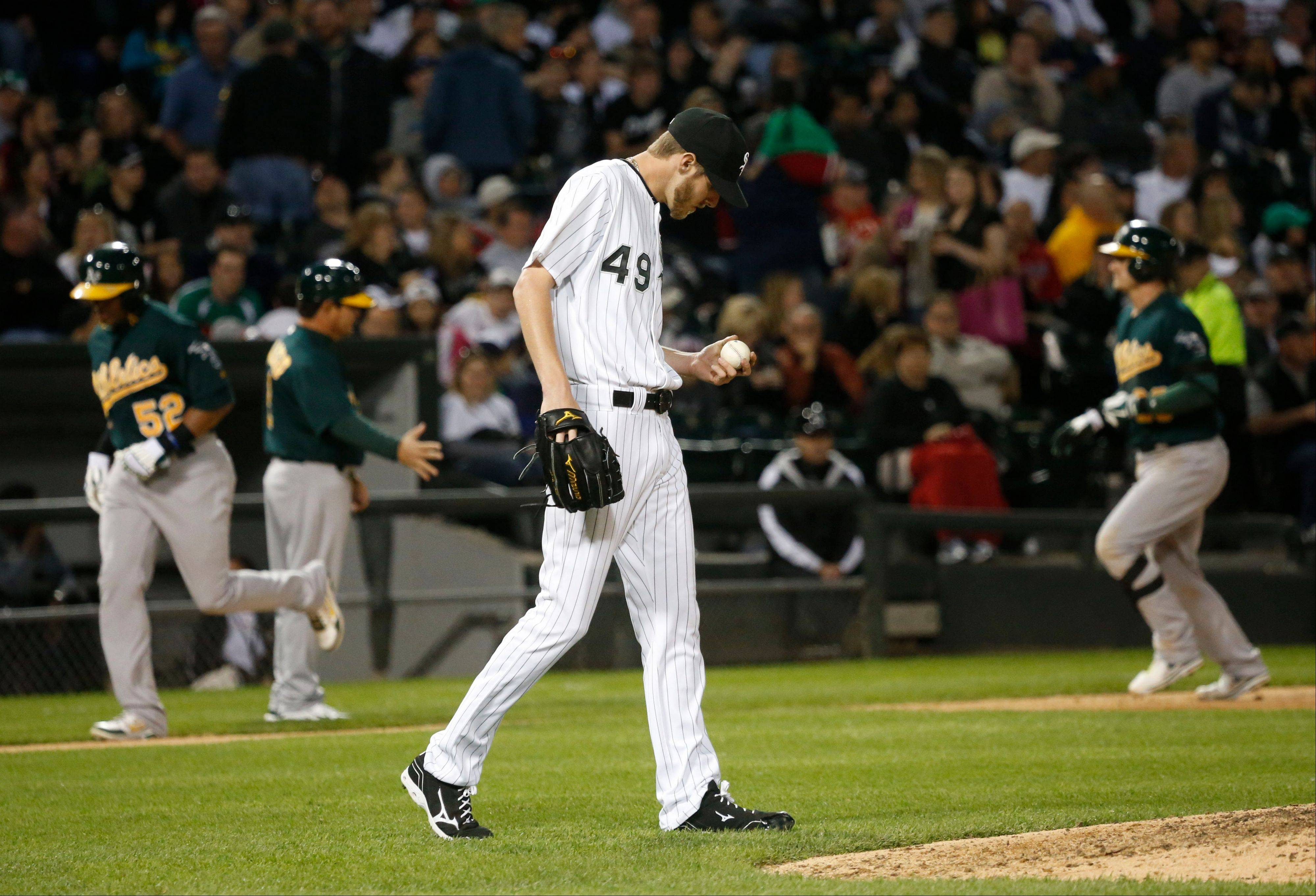 Chicago White Sox starting pitcher Chris Sale center returns to the mound after giving & Au0027s slam door on Sox win 4-3