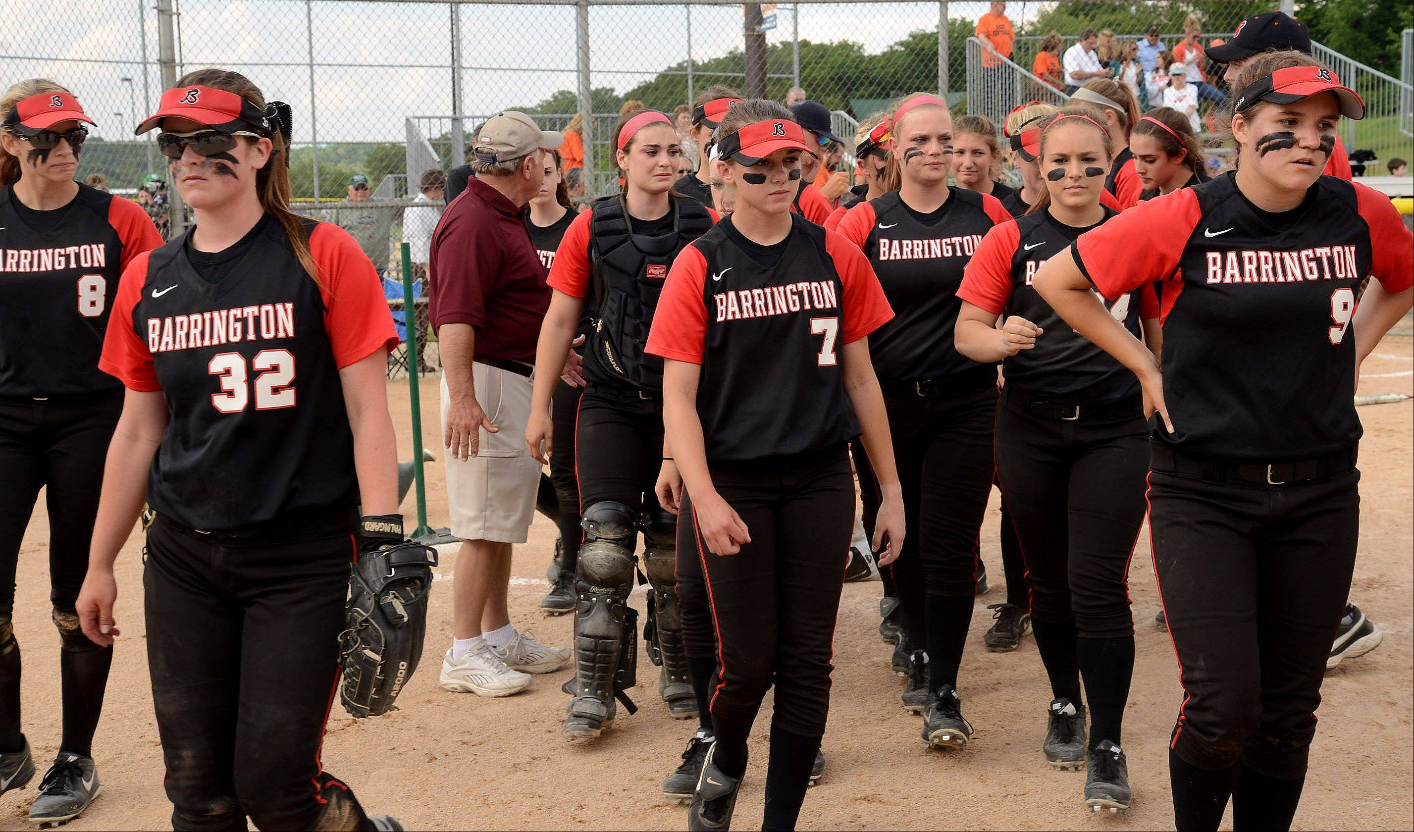 A dejected Barrington team leaves the field after falling short against St. Charles East in the Class 4A state semifinals.