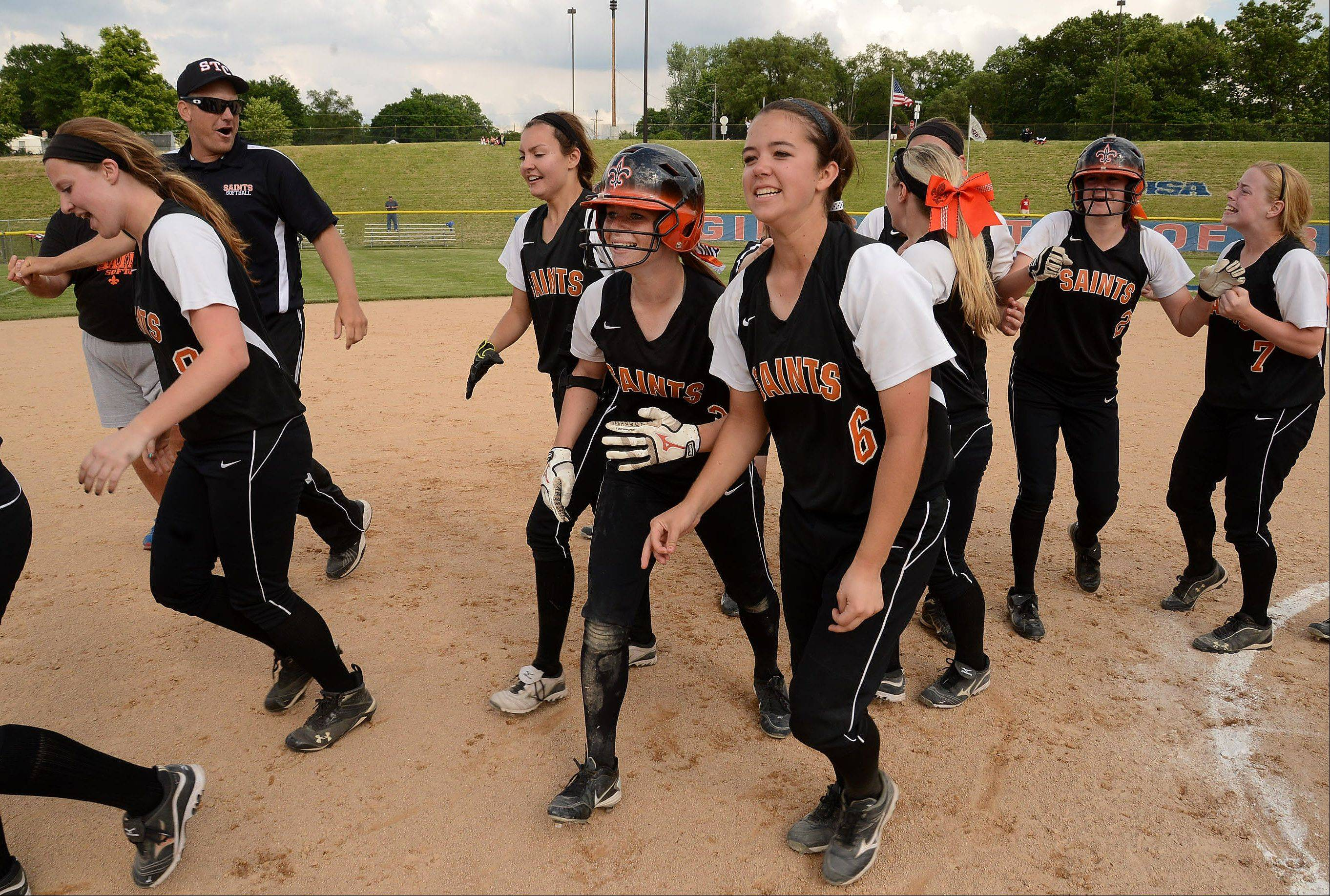 St. Charles celebrates after defeating Barrington in the bottom of the seventh inning on a game-winning two-out double by Olivia Lorenzini in the Class 4A state semifinals.