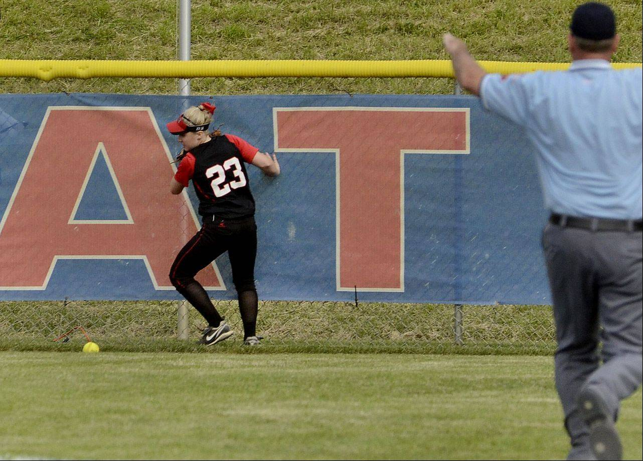 Barrington center fielder Tess Bolger tries to retrieve the game-winning 2-run double by Olivia Lorenzini of St. Charles East in the bottom of the seventh inning of the Class 4A state semifinals.