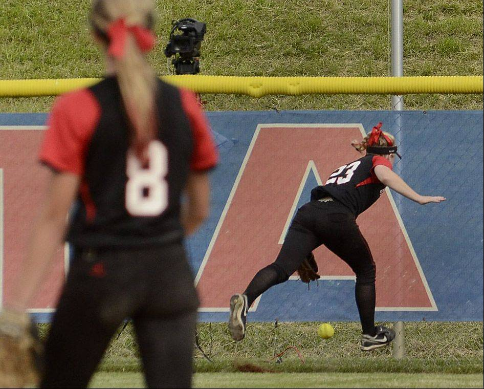 Barrington center fielder Tess Bolger tries to retrieve the game winning 2-run double struck by Olivia Lorenzini of St. Charles East in the bottom of the seventh inning of the Class 4A state semifinals.
