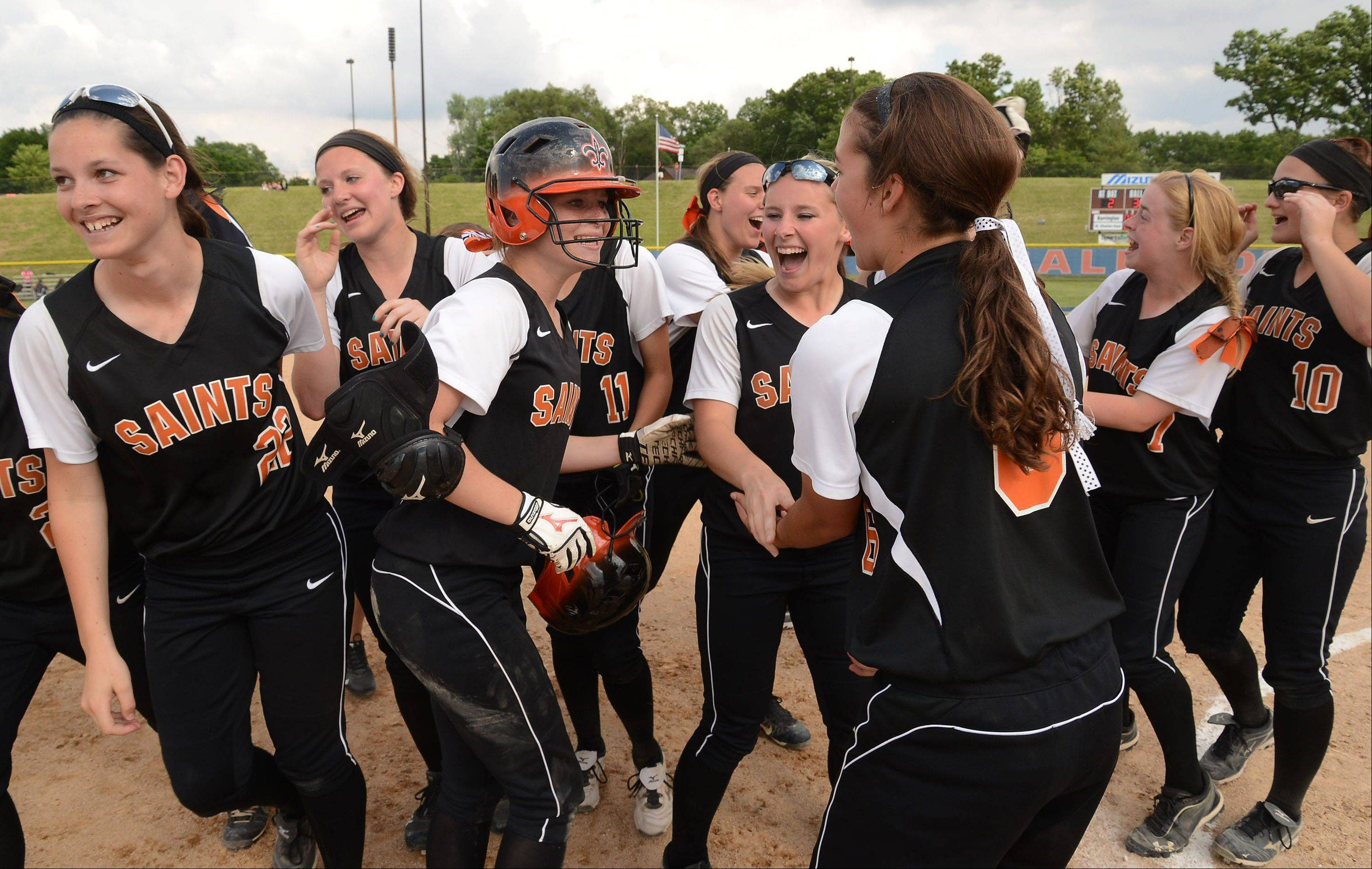 St. Charles East celebrates after defeating Barrington in the bottom of the seventh inning on a game-winning two-out double by Olivia Lorenzini in the Class 4A state semifinals.
