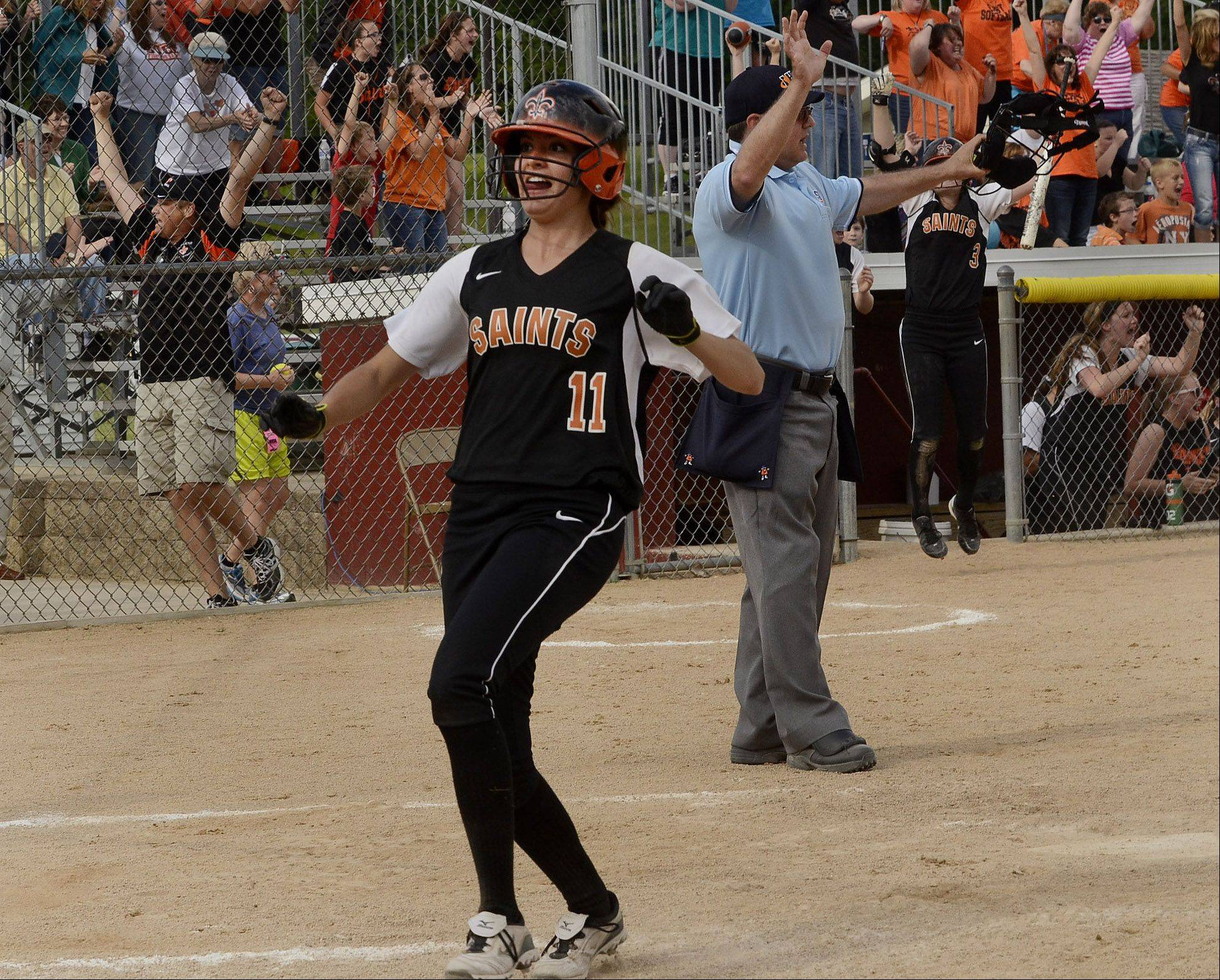 Tess Hupe of St. Charles East scores the game winning run in the bottom of the seventh inning on a 2-run double by Olivia Lorenzini in the Class 4A state semifinals.