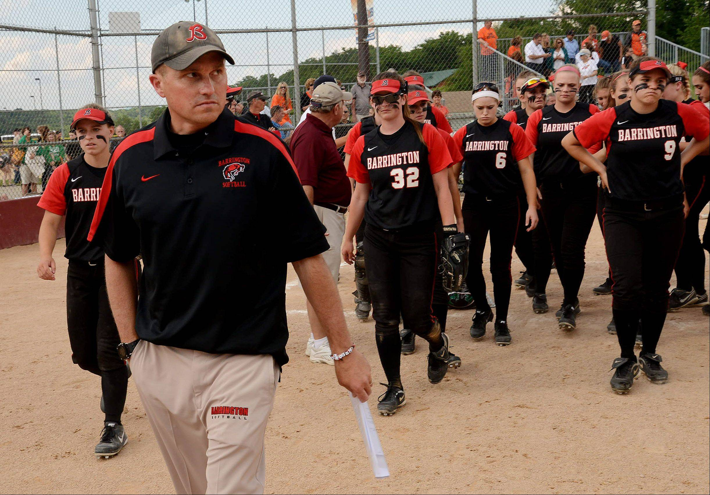 Barrington coach Perry Peterson leads his dejected team off the field after the Fillies fell shot against St.Charles East in the Class 4A state semifinals.