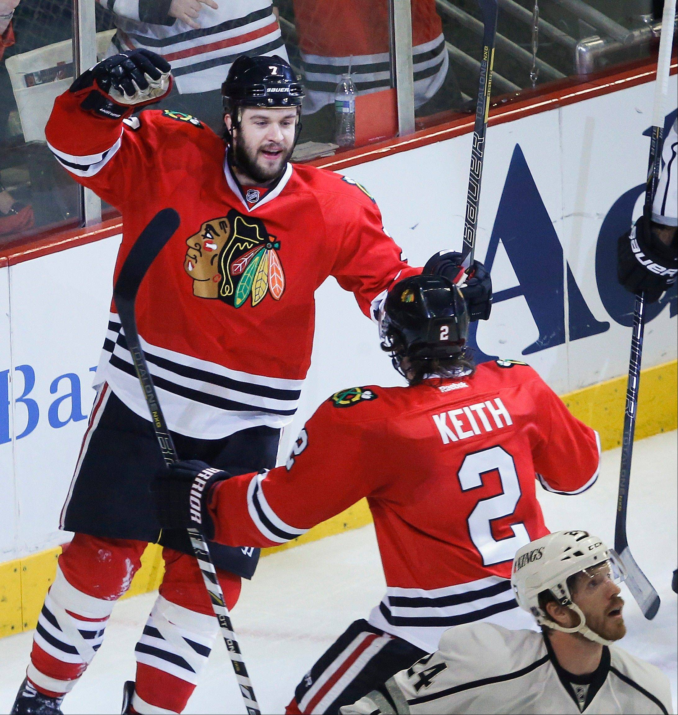 Blackhawks defenseman Brent Seabrook (7) celebrates with defenseman Duncan Keith (2) after scoring a goal against the Los Angeles Kings during the first period in Game 2 of the NHL hockey Stanley Cup Western Conference finals Sunday, June 2, 2013 in Chicago.