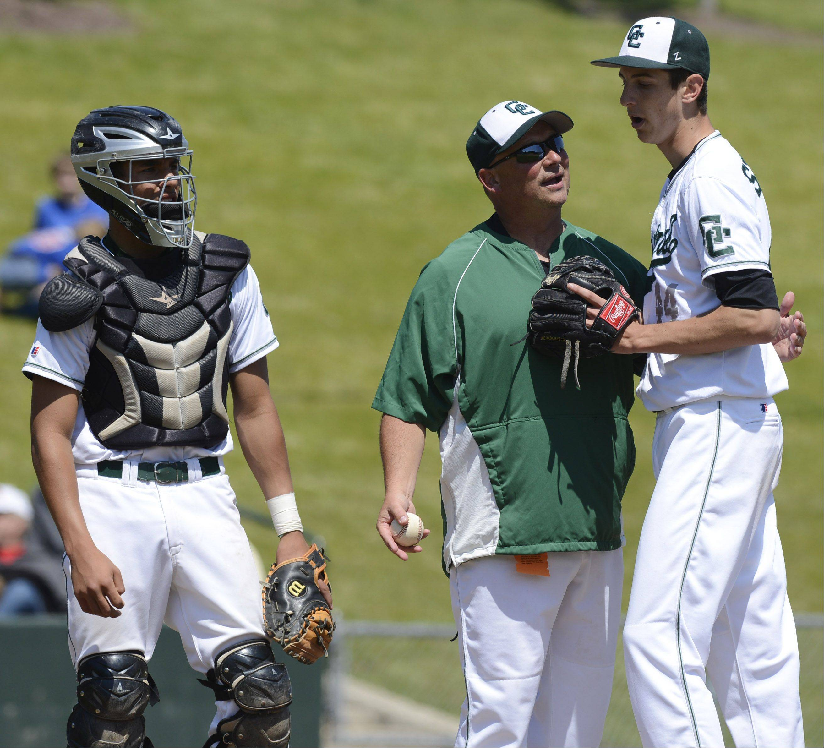 Grayslake Central coach Troy Whalen replaces starting pitcher Jack Spicer as catcher Freddie Landers stands by during the Class 3A state baseball tournament at Silver Cross Field in Joliet on Friday.