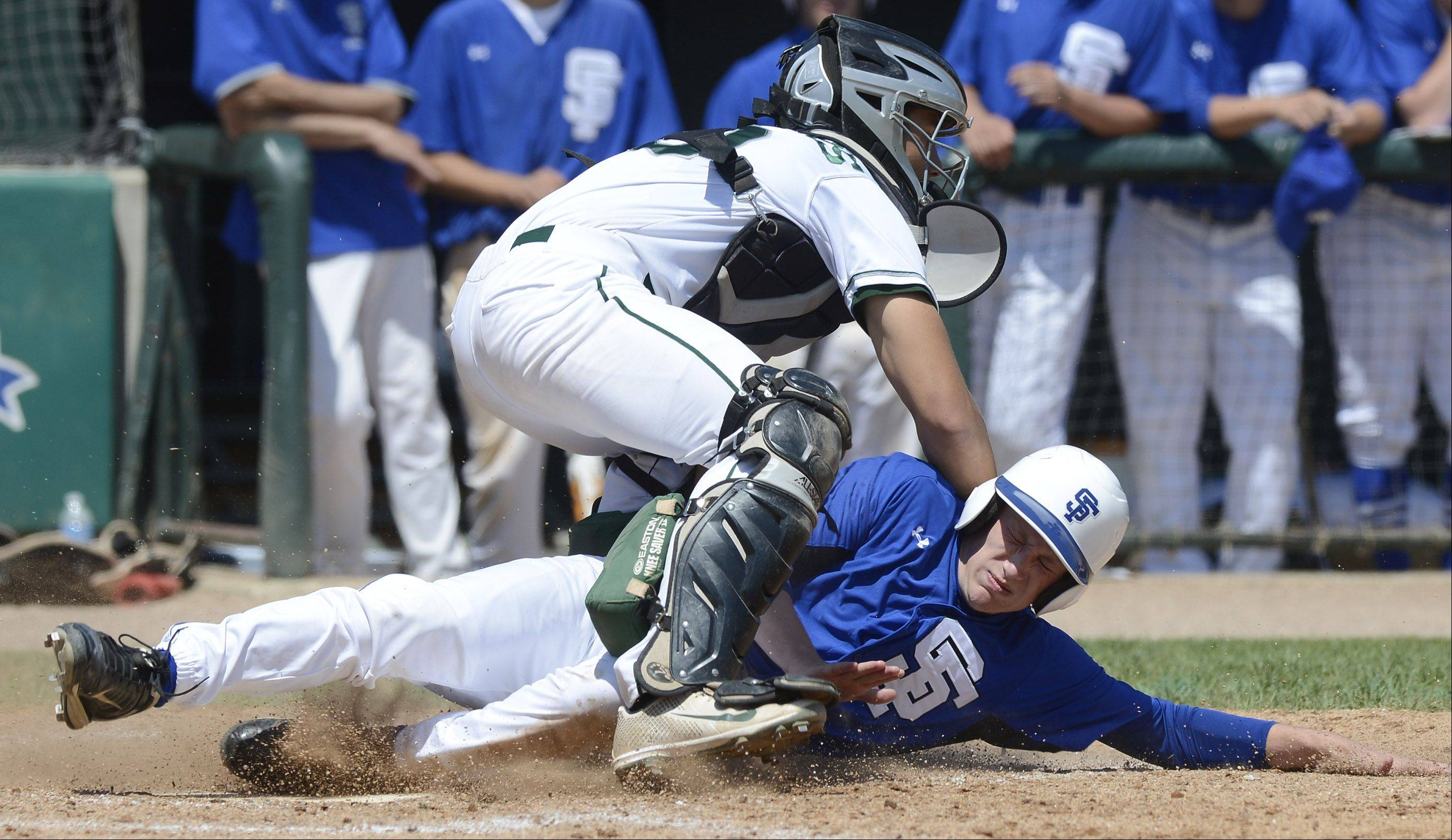 Jake Radel of St. Francis gets tagged out at the plate by Grayslake Central catcher Freddie Landers during the Class 3A state baseball semifinal at Silver Cross Field in Joliet on Friday.