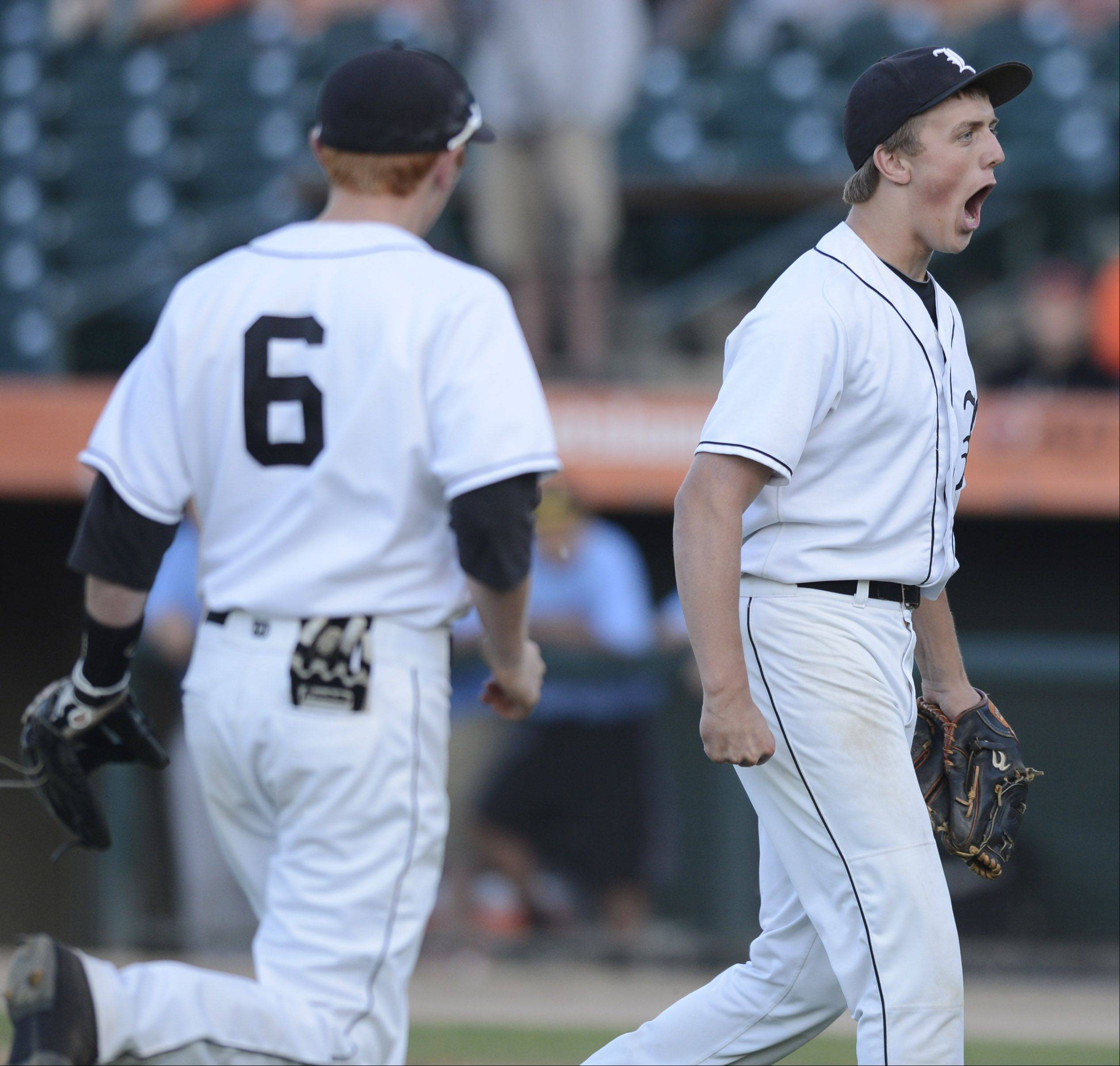 Libertyville pitcher Kevin Calamari celebrates after closing his team's 9-6 victory over St. Charles East during the Class 4A state baseball semifinals at Silver Cross Field in Joliet Friday as teammate P.J. Neumann runs over to congratulate him.