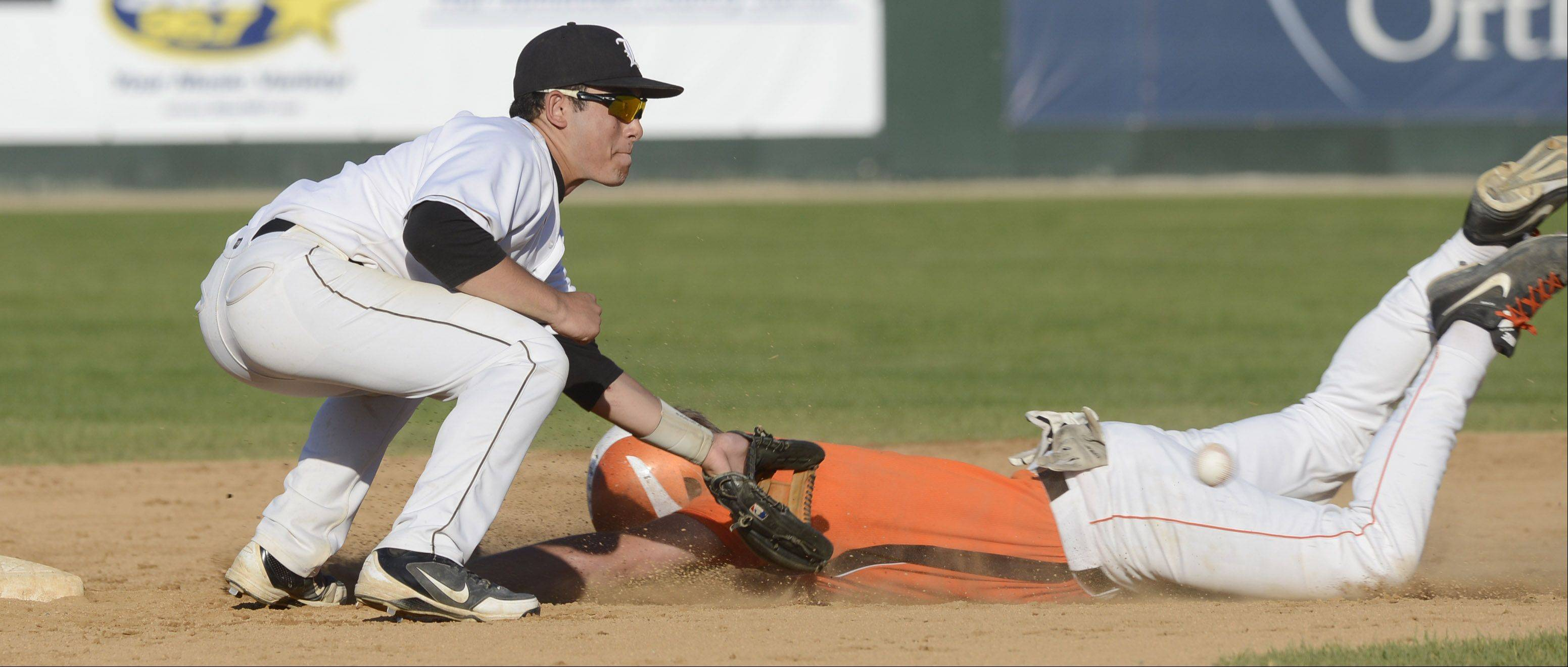 St. Charles East's Erik Anderson steals second base as Libertyville's Noah Greenberg applies the tag in the fourth inning.