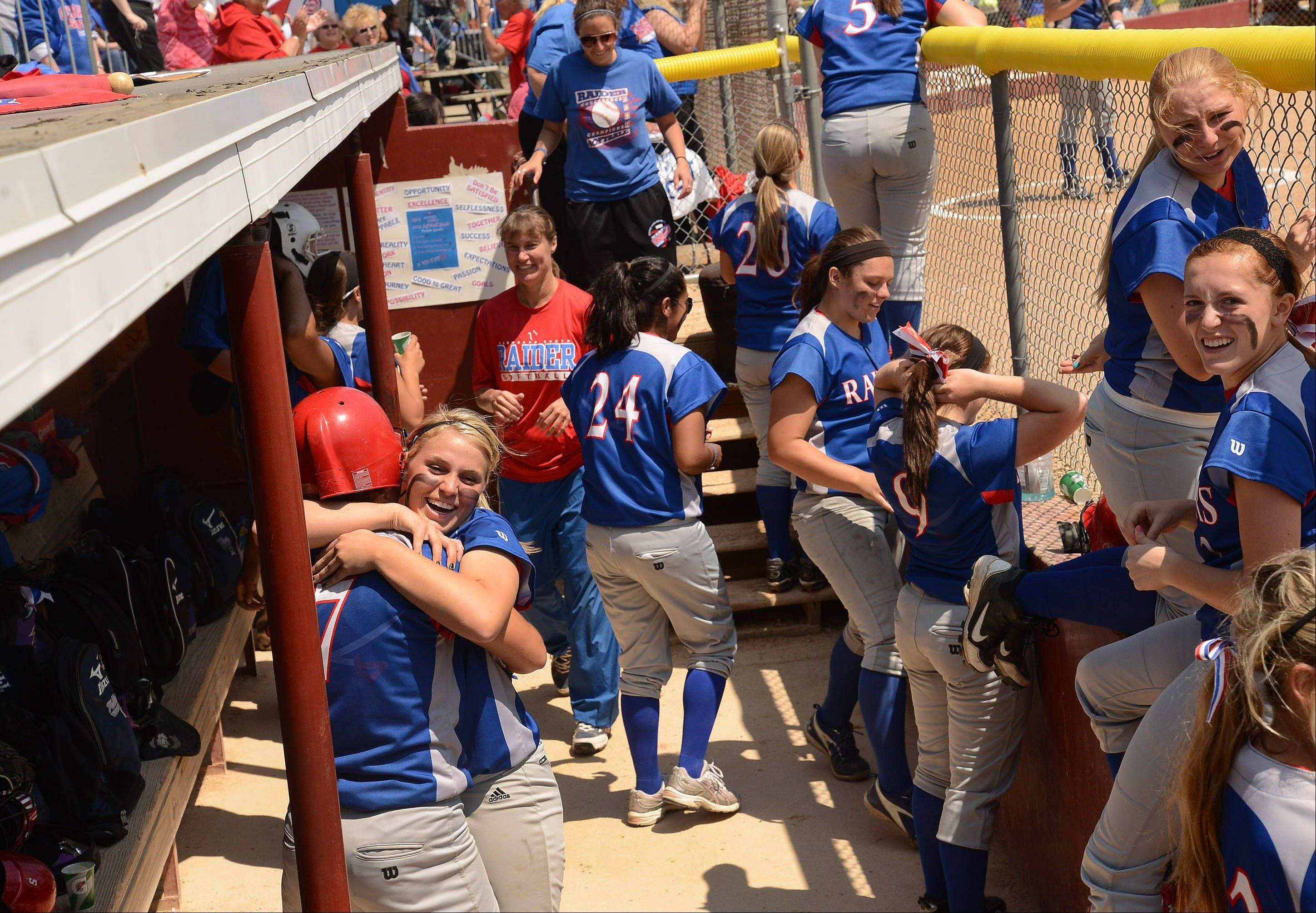 Glenbard South's Hannah Taylor is hugged by pitcher Stephanie Chitkowski after hitting a two-run home run in the 4th inning of the Class 3A state semifinal between Glenbard South and Tinley Park.