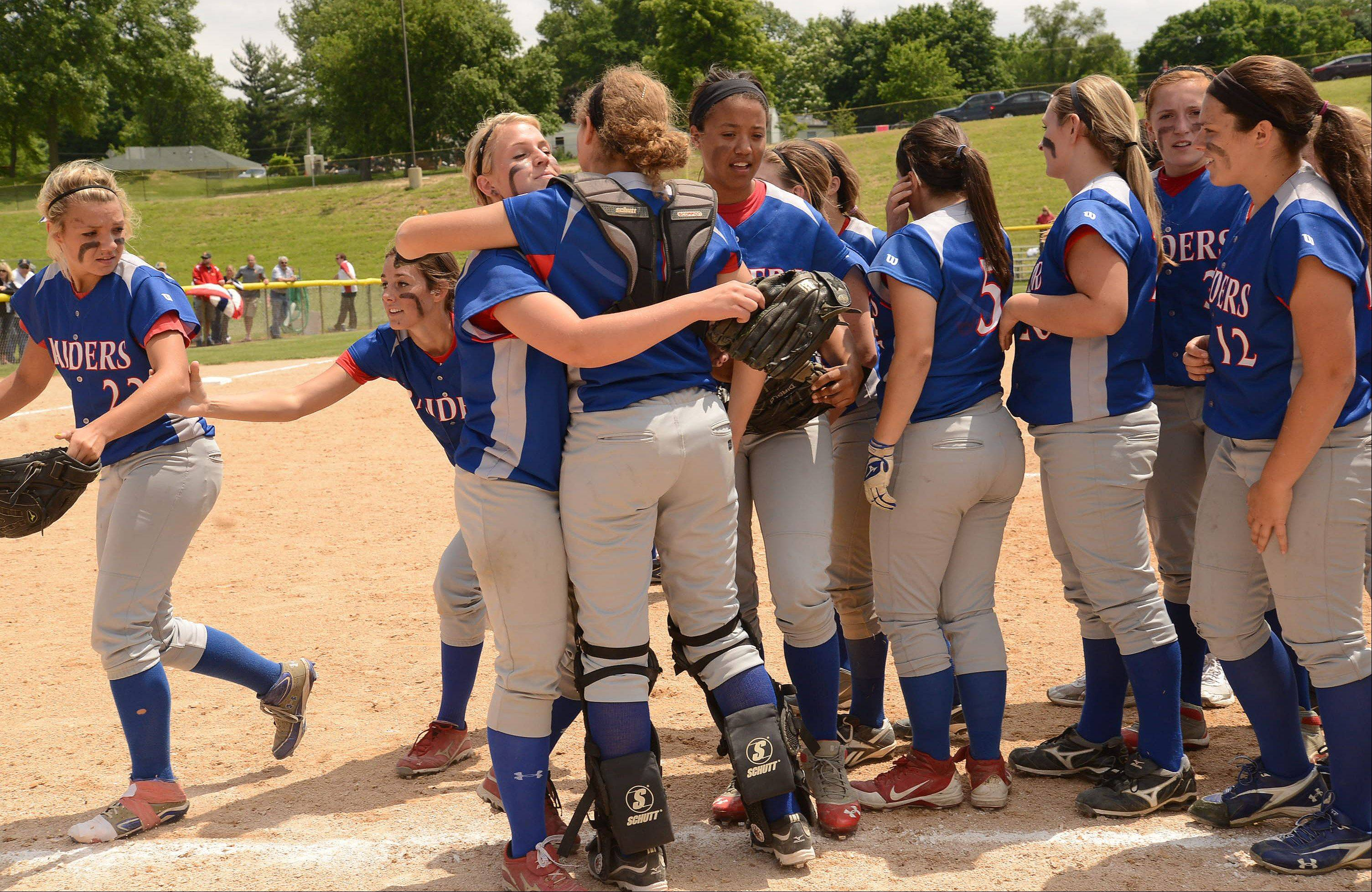 Glenbard South celebrates after winning their Class 3A state semifinal game against Tinley Park.