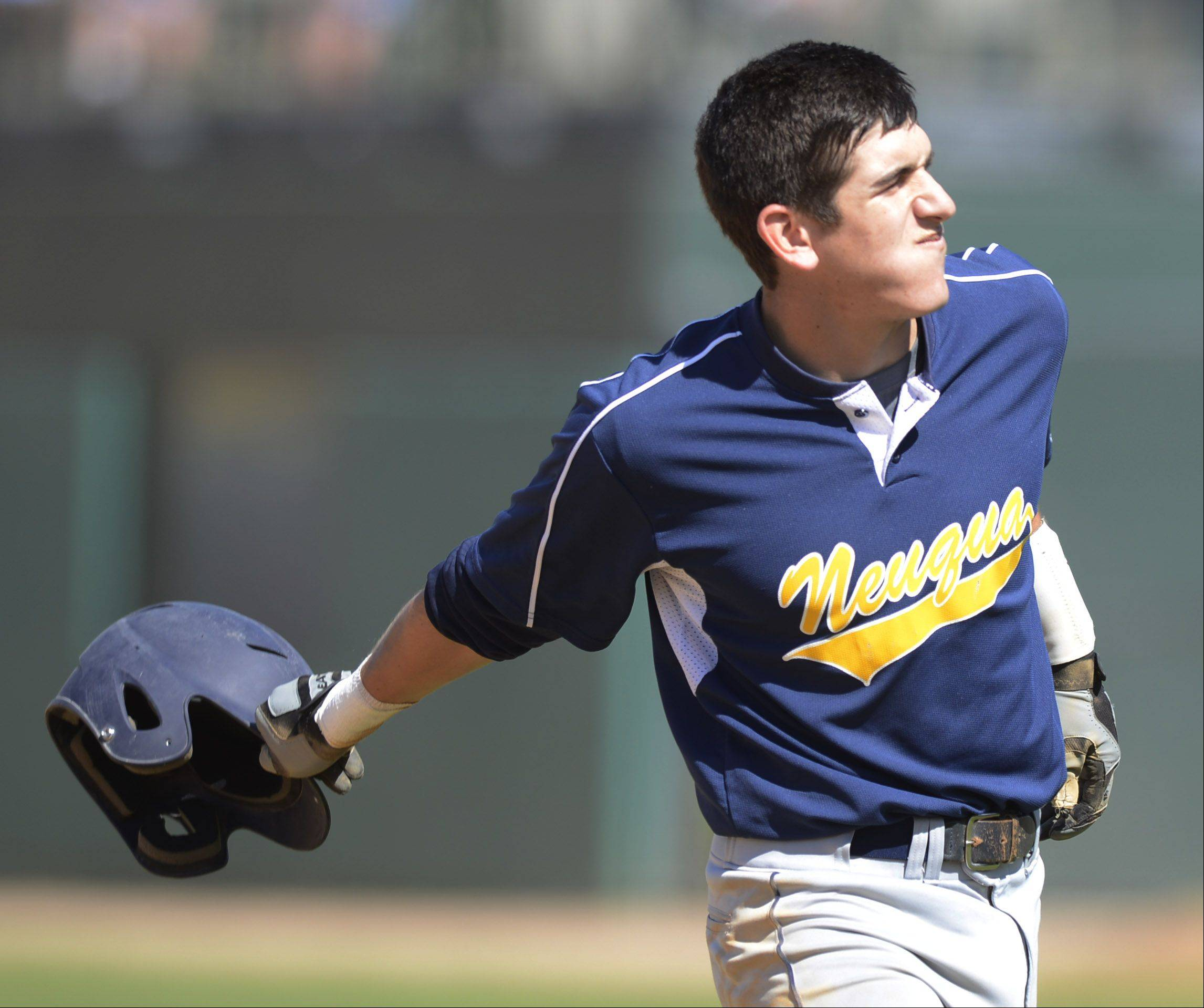 Neuqua Valley's Drew Sterioti flips his helmet at the end of the fourth inning during the Class 4A state baseball semifinals against Mt. Careml at Silver Cross Field in Joliet Friday.