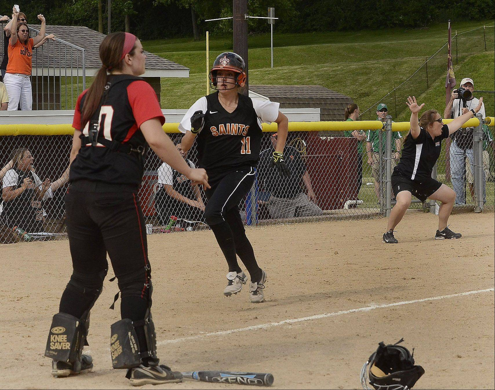 Tess Hupe of St. Charles East hustles home with the game-winning run.