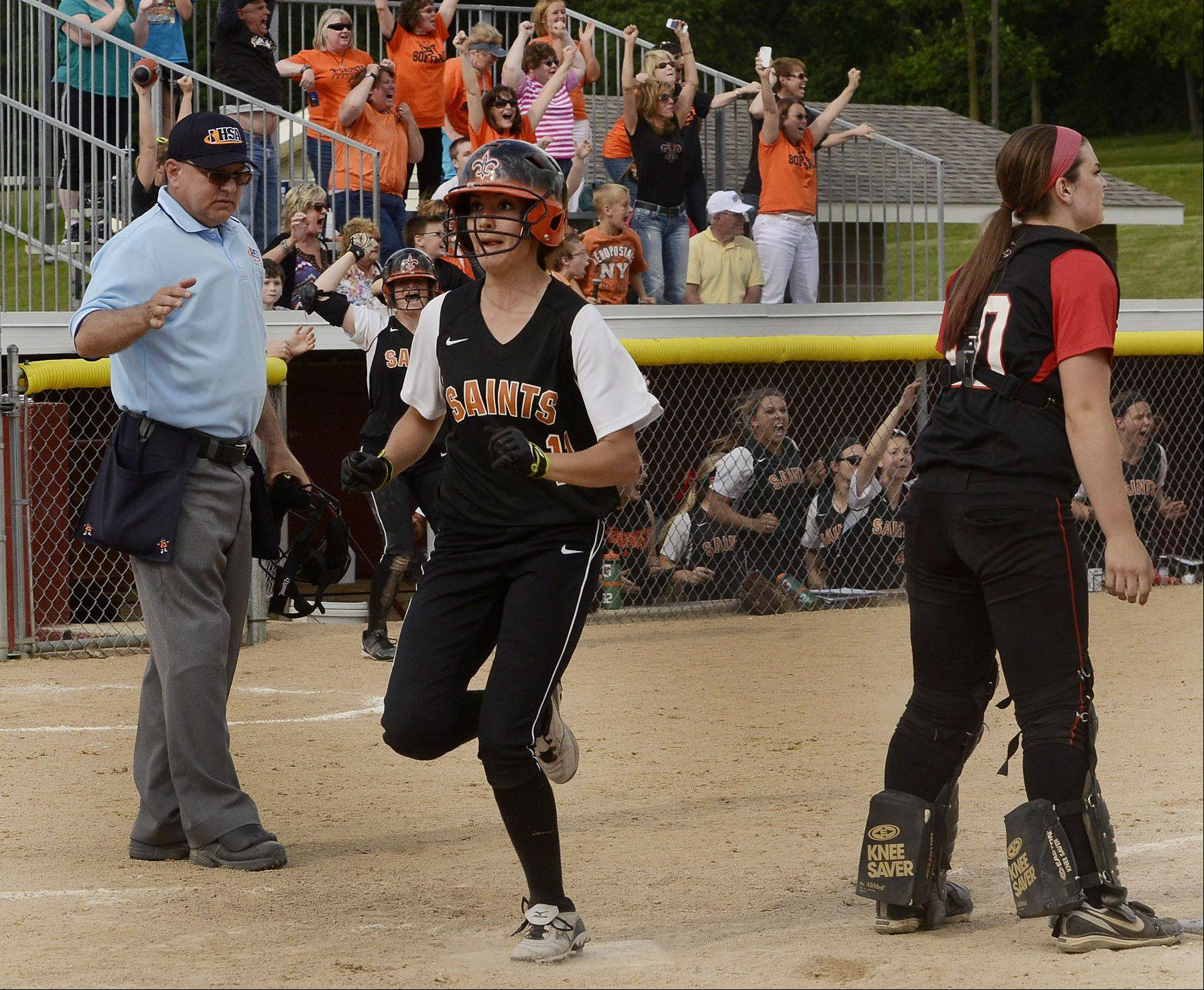 Tess Hupe of St. Charles East scores the game-winning run.