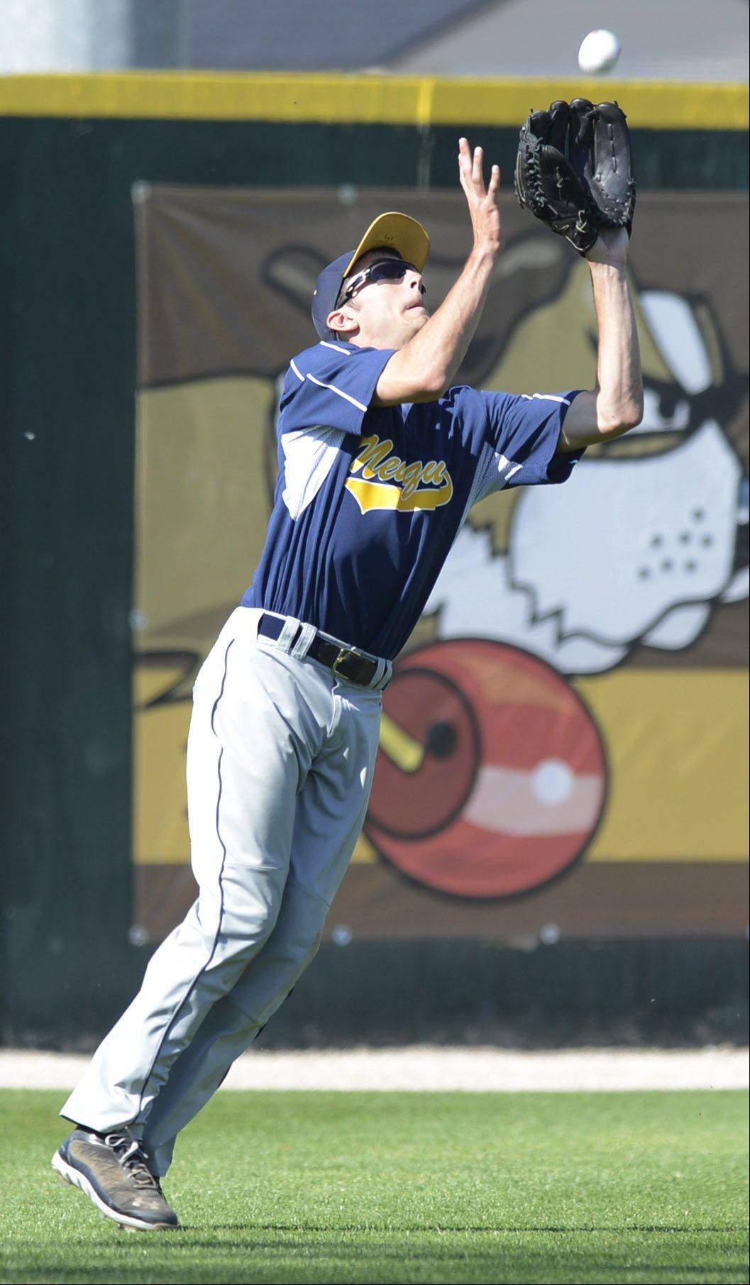 Neuqua Valley left fielder Josh Piotrowski catches a fly ball during the top of the seventh inning .